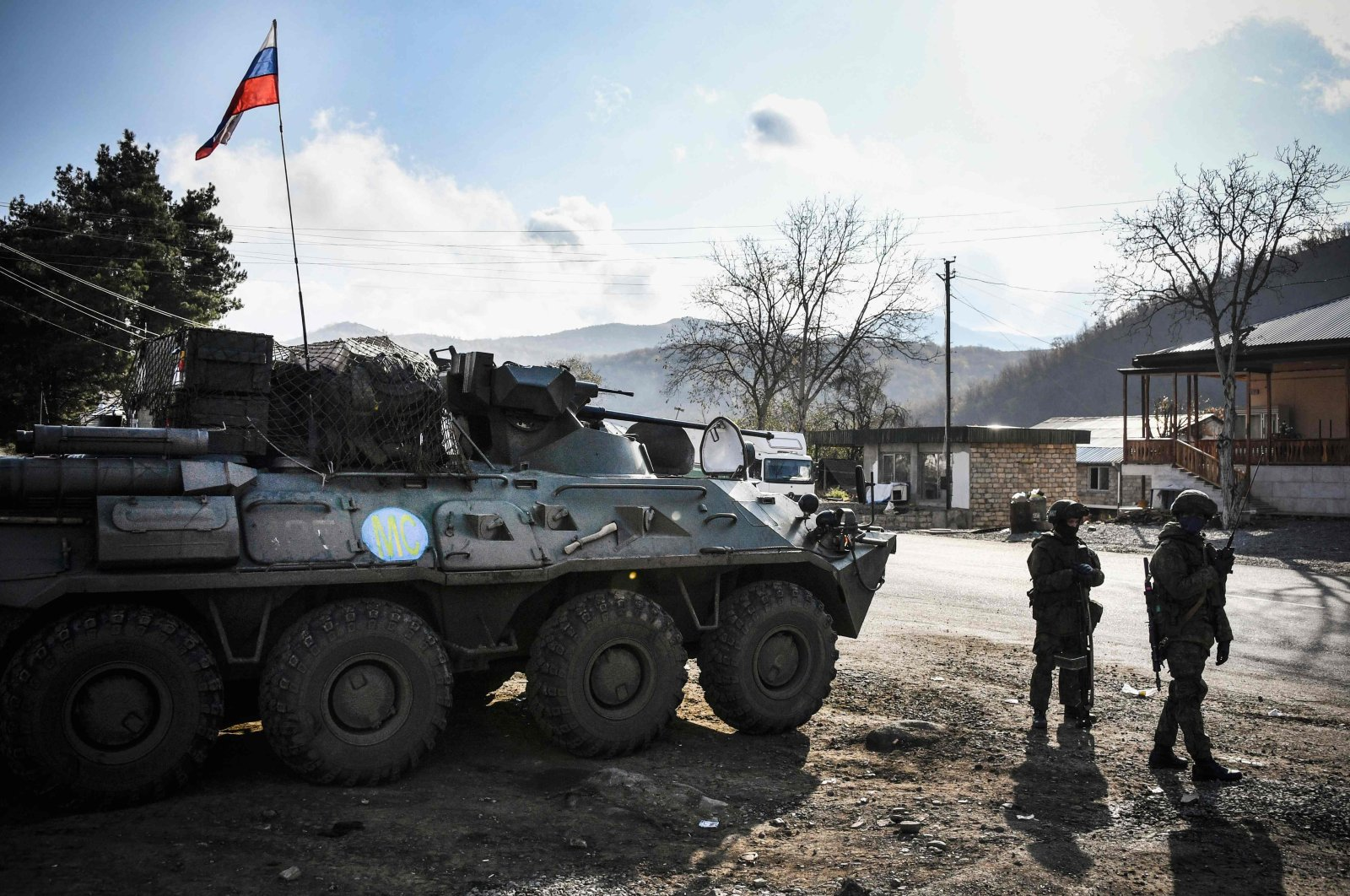 Russian peacekeepers stand beside an armored vehicle at their checkpoint as part of the Karabakh deal, outside the town of Kalbajar, Azerbaijan, Nov. 14, 2020. (AFP Photo)