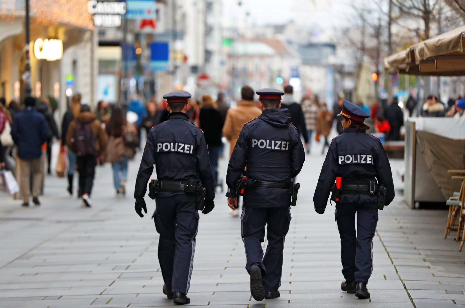 Police officers walk down a shopping street after the Austrian government announced a lockdown including the closure of all nonessential shops, as the spread of coronavirus continues, in Vienna, Austria, Nov. 16, 2020. (Reuters Photo)