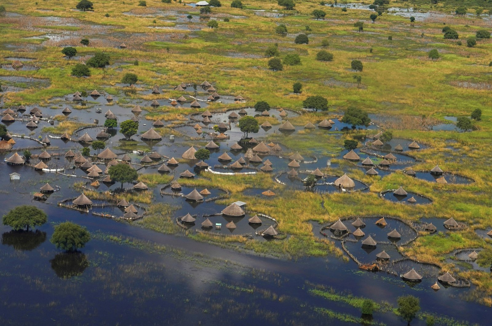 An aerial view shows flooded homes within a village after the Nile broke the dikes in Jonglei State, South Sudan, Oct. 5, 2020. (REUTERS Photo)
