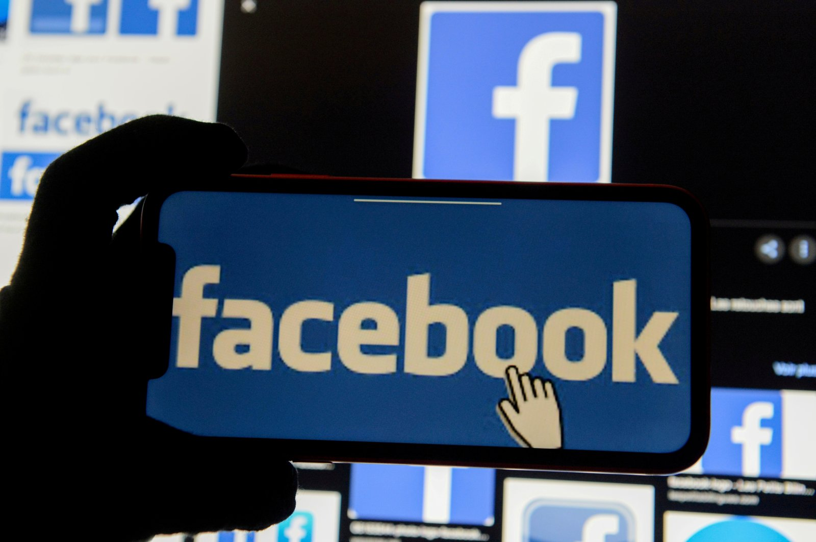 The Facebook logo is displayed on a mobile phone in this picture illustration taken Dec. 2, 2019. (REUTERS Photo)