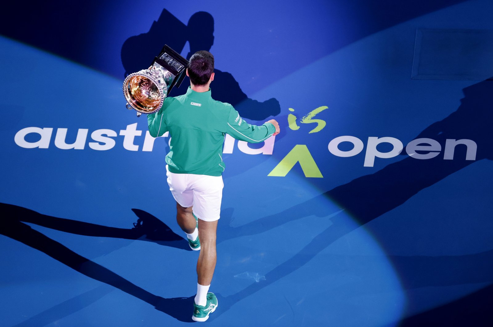 Novak Djokovic holds his trophy after winning the Australian Open tennis tournament, in Melbourne, Australia, Feb. 3, 2020. (AP Photo)