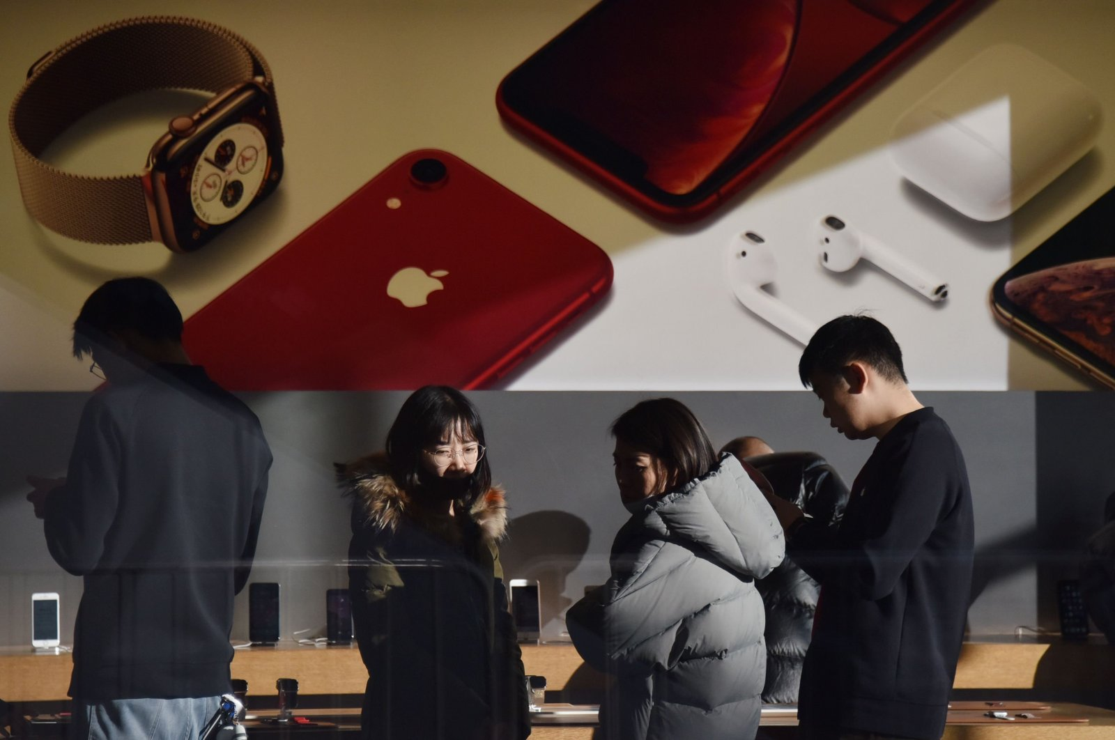 Customers look at products in an Apple store in Beijing, China, Dec. 11, 2018. (AFP Photo)
