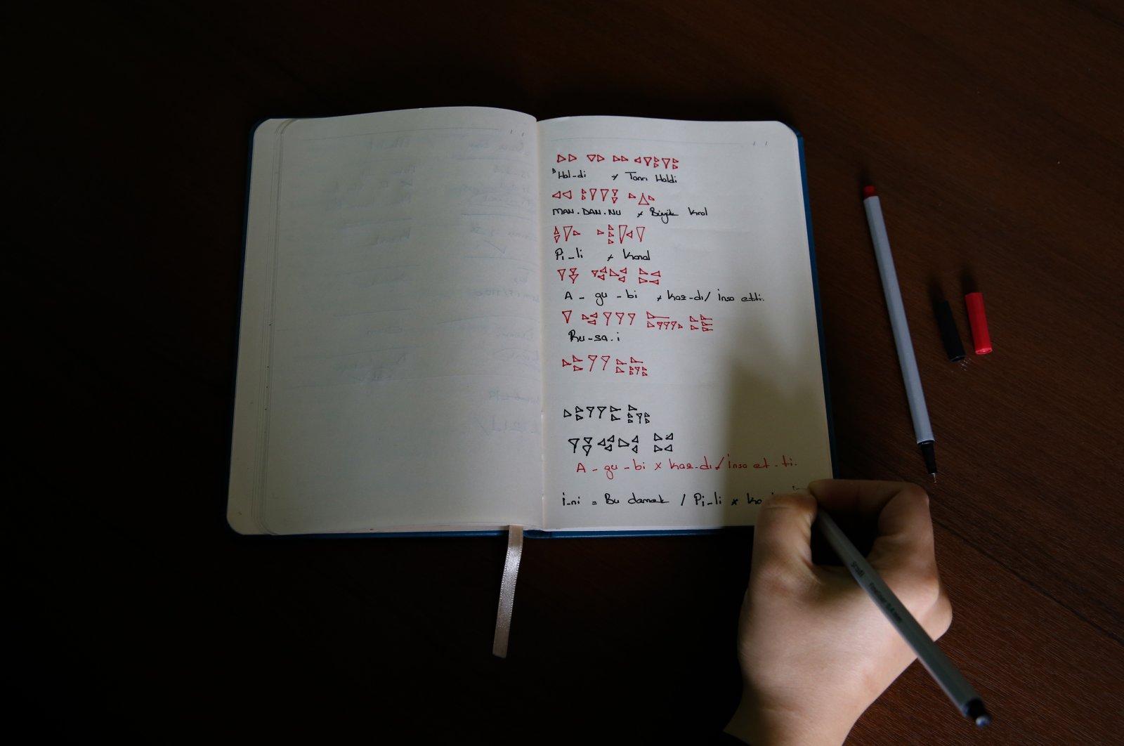 A student's Urartian notes in a notebook at Yüzüncü Yıl University, Van, eastern Turkey, Nov. 16, 2020. (AA Photo)