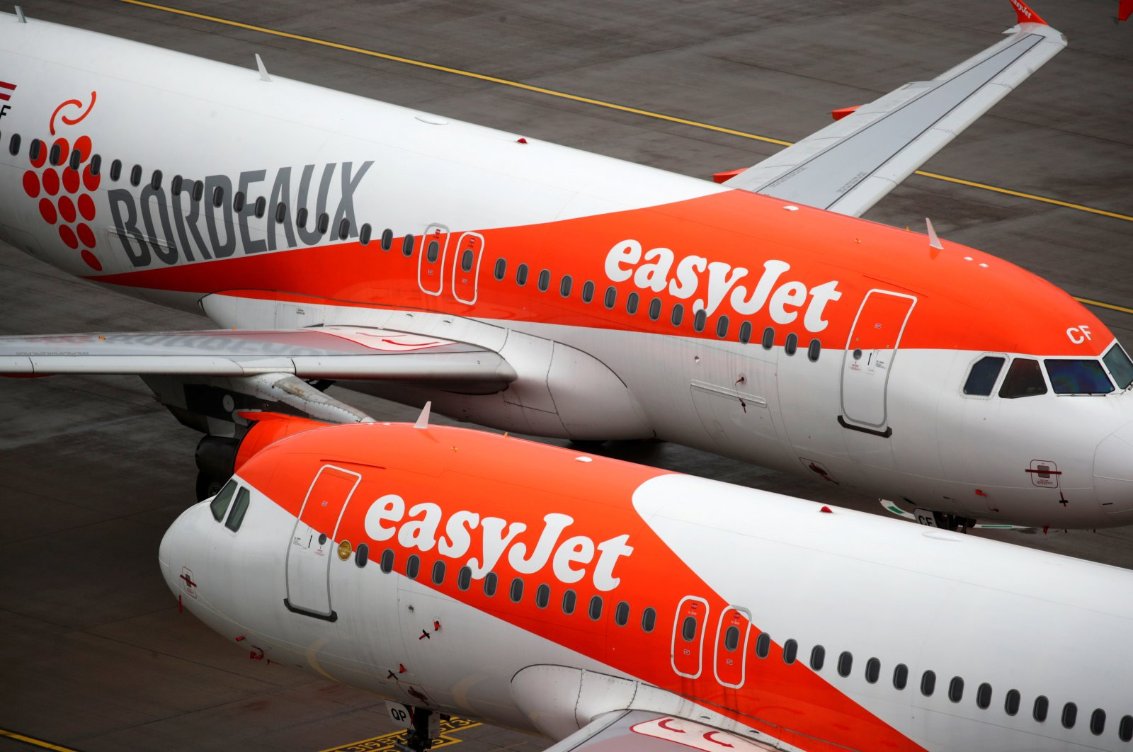 """EasyJet aircraft are seen on the tarmac at Terminal 1, marking the official opening of the new Berlin-Brandenburg Airport (BER) """"Willy Brandt,"""" in Schoenefeld near Berlin, Germany, Oct. 31, 2020. (Reuters Photo)"""