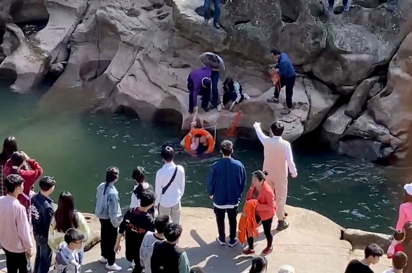 Stephen Ellison, British consul-general in Chongqing, rescues a drowning student, who had fallen into a river by accident, at a scenic spot in Chongqing, China, Nov. 14, 2020.(British consulate in Chongqing via Reuters TV)