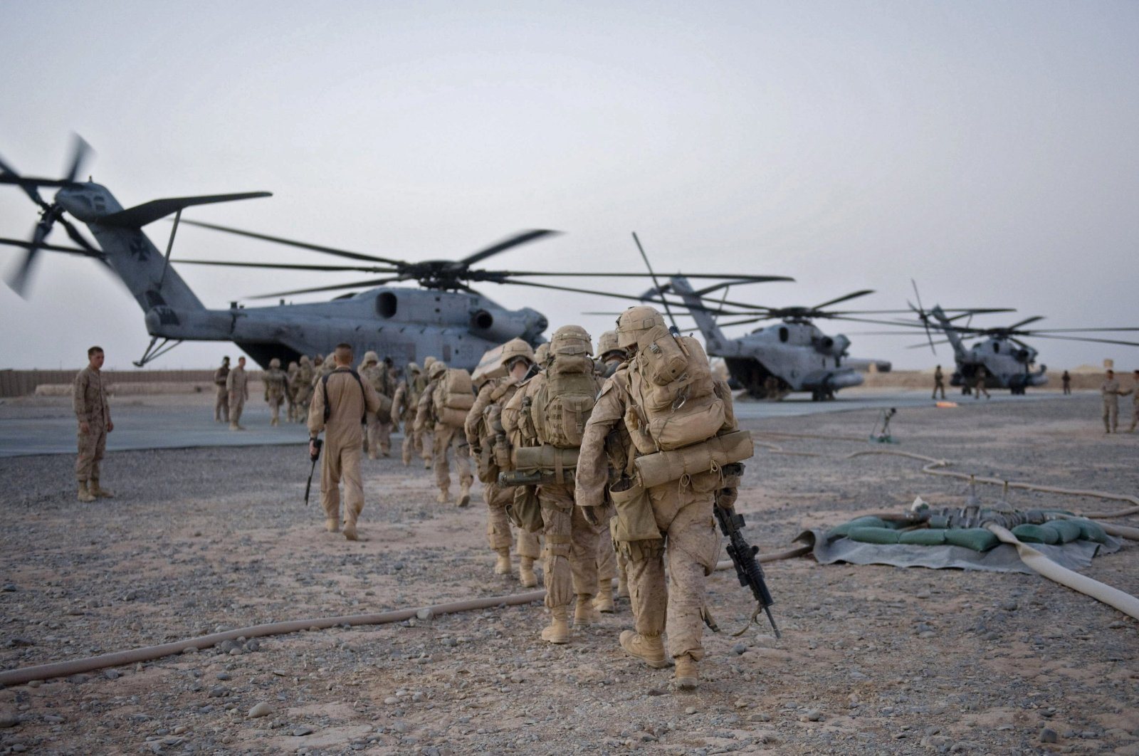 U.S. Marines from the 2nd Battalion, 8th Marine Regiment of the 2nd Marine Expeditionary Brigade walk toward the helicopter as part of Operation Khanjar at Camp Dwyer in Helmand Province in Afghanistan on July 2, 2009.  (AFP Photo)