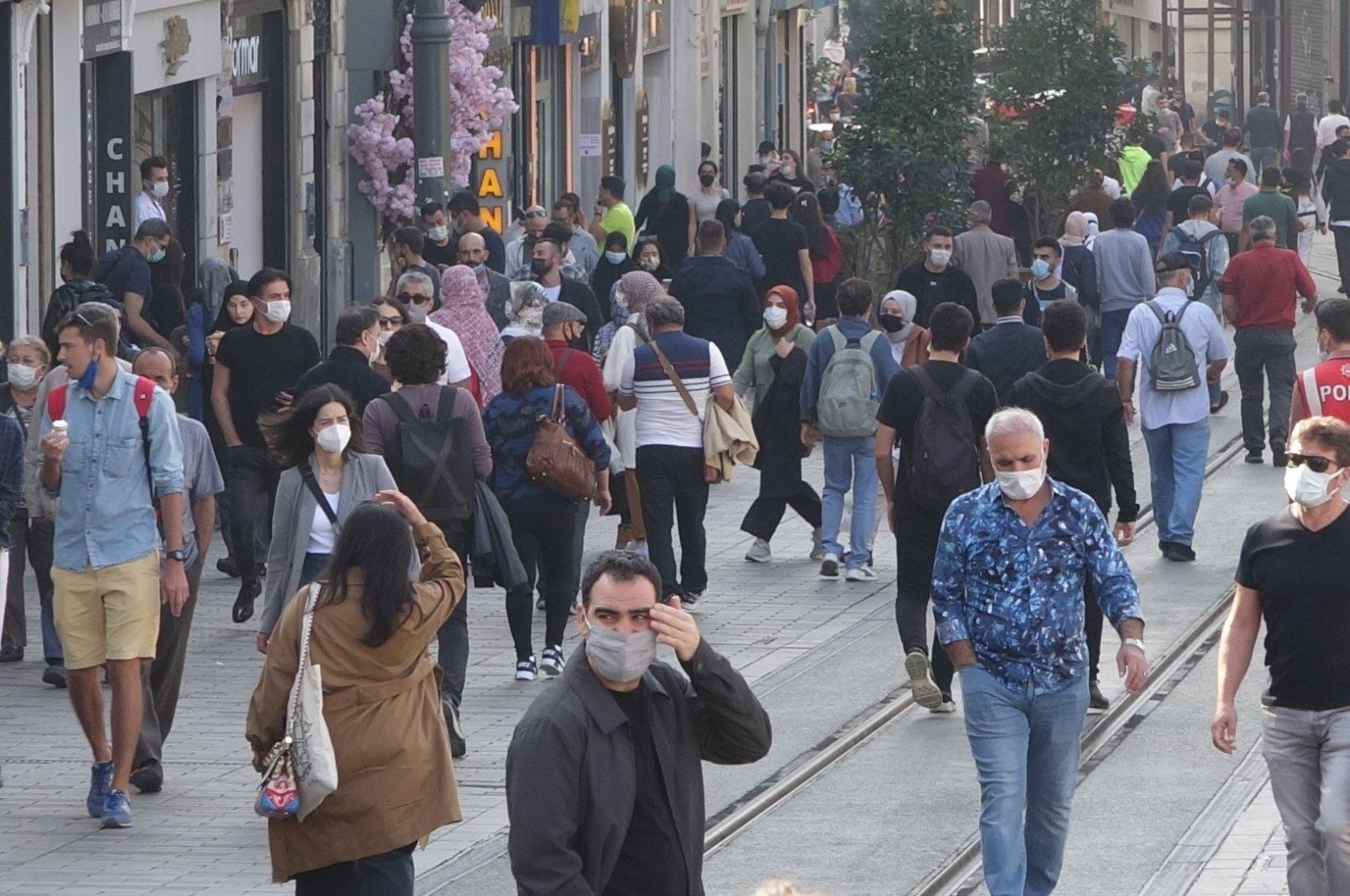 People walk on Istiklal Street in Istanbul, Turkey, Nov. 17, 2020. (DHA Photo)