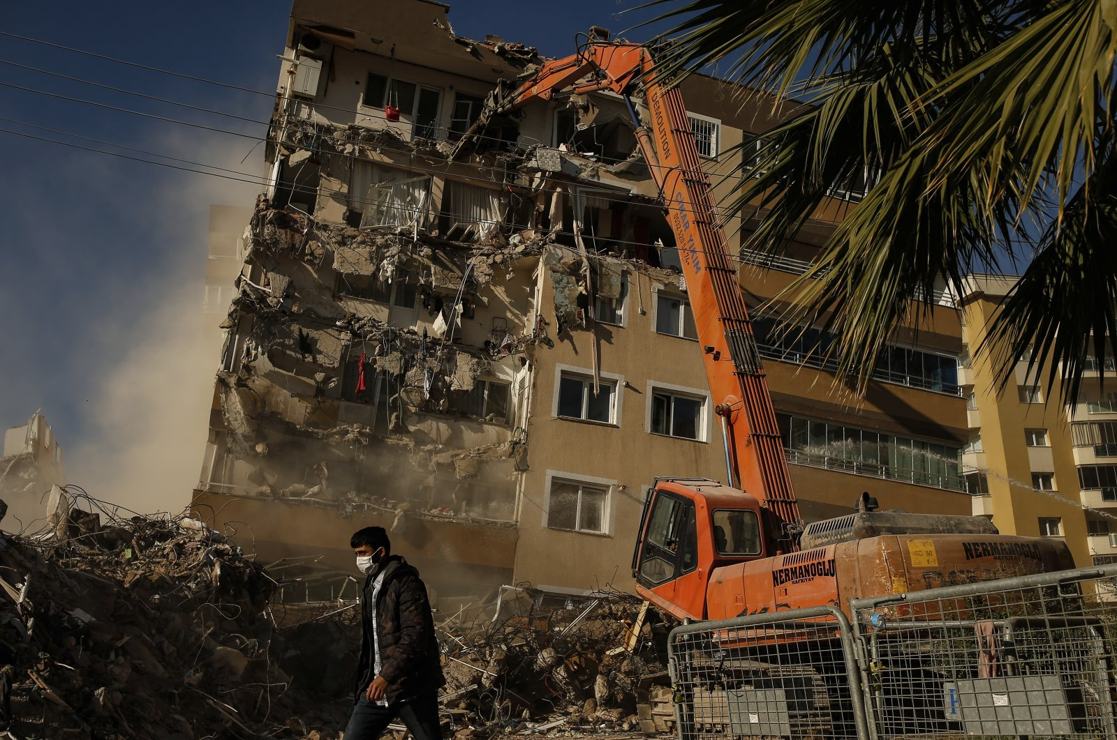 Construction workers demolish a building that was damaged during the Oct. 30 earthquake in Izmir, Turkey, Nov. 4, 2020. (AP Photo)