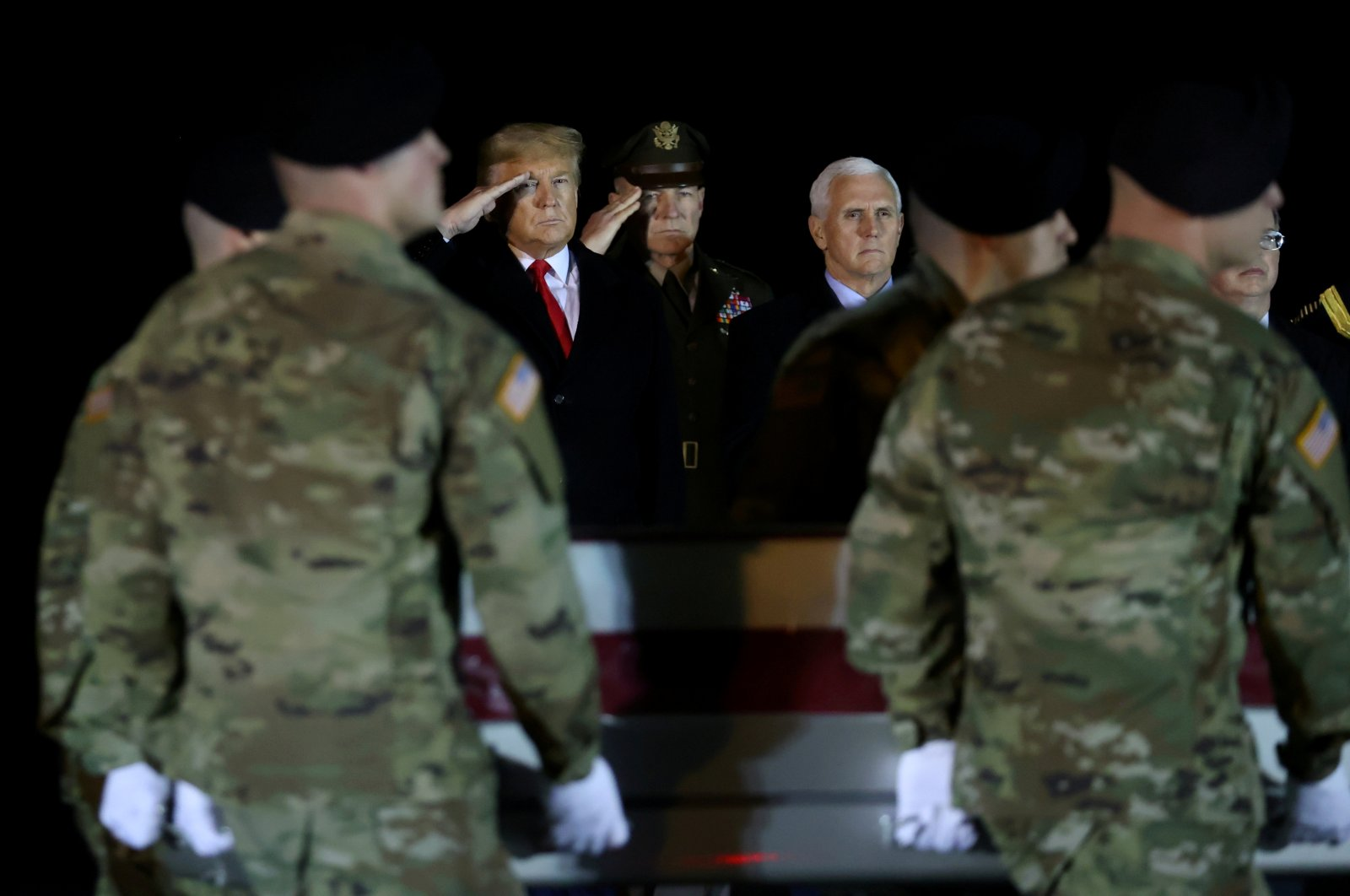 U.S. President Donald Trump salutes the transfer cases holding the remains of U.S. Army soldier Sergeant Javier Jaguar Gutierrez, who was killed in the Nangarhar province in eastern Afghanistan, during a dignified transfer at Dover Air Force Base, in Dover, Delaware, U.S. Feb. 10, 2020. (REUTERS Photo)