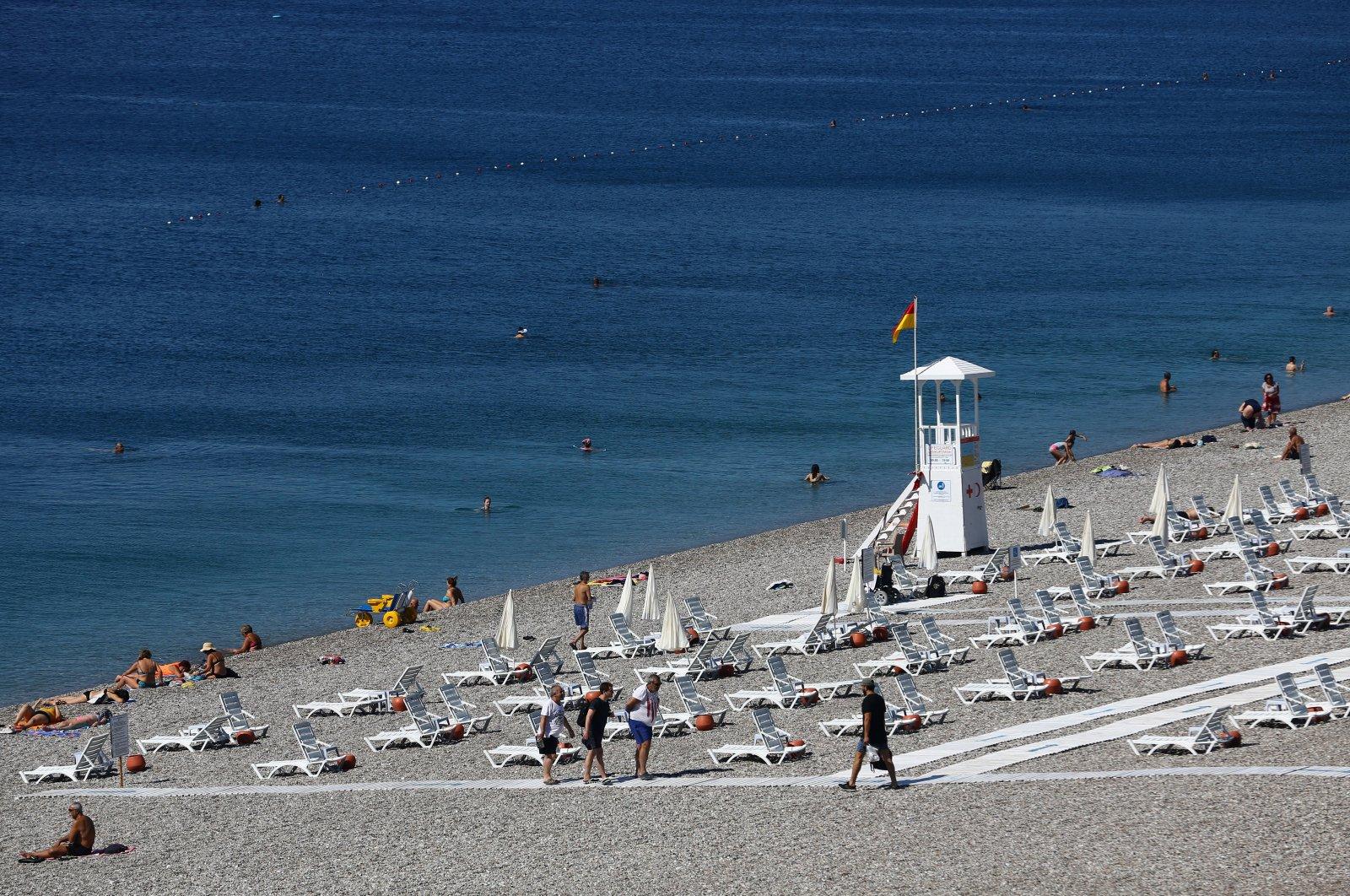 People sunbathe on Konyaaltı beach in the southern resort city of Antalya, Turkey, amid the COVID-19 outbreak, on June 19, 2020. (Reuters Photo)