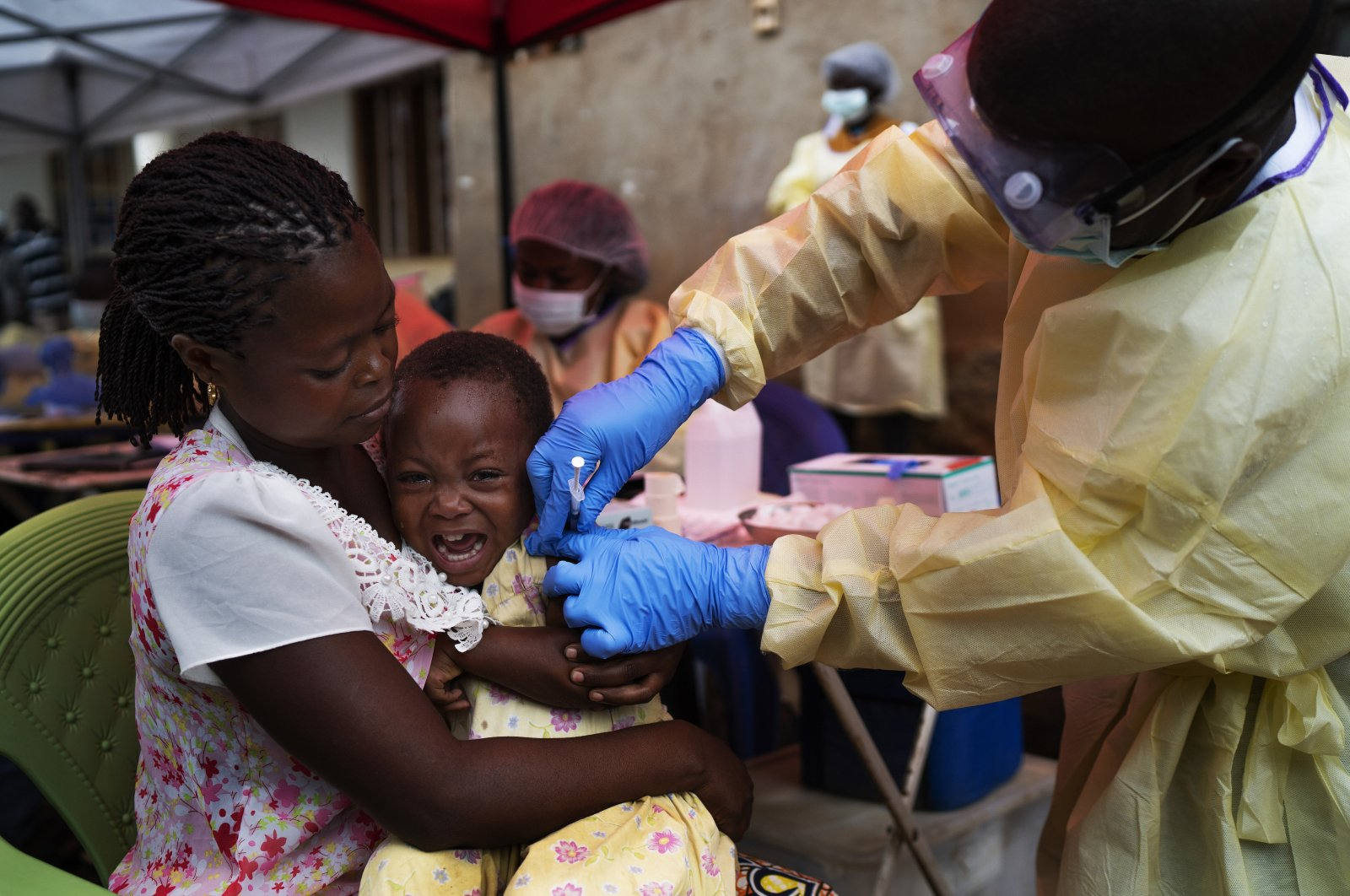 A child is vaccinated against Ebola, Beni, Congo, July 13, 2019. (AP Photo)