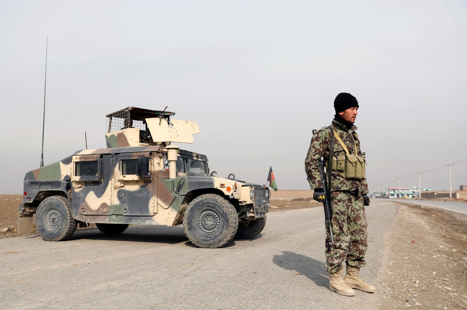 An Afghan National Army (ANA) soldier stands guard at a checkpoint on the outskirts of Kabul, Nov. 18, 2020. (Reuters Photo)