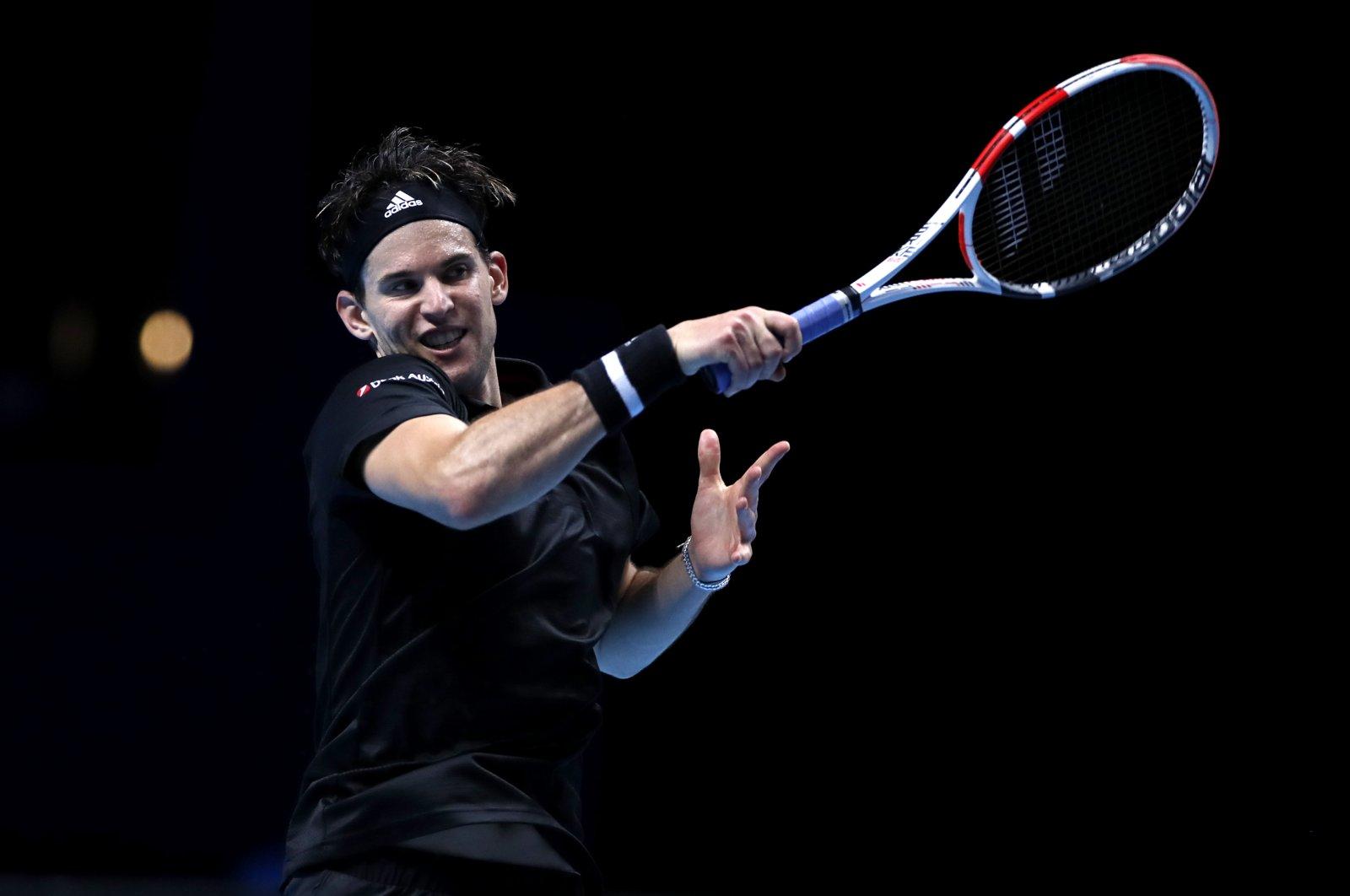 Dominic Thiem returns Rafael Nadal's shot during an ATP Masters tennis match in London, Britain, Nov. 17, 2020. (Reuters Photo)