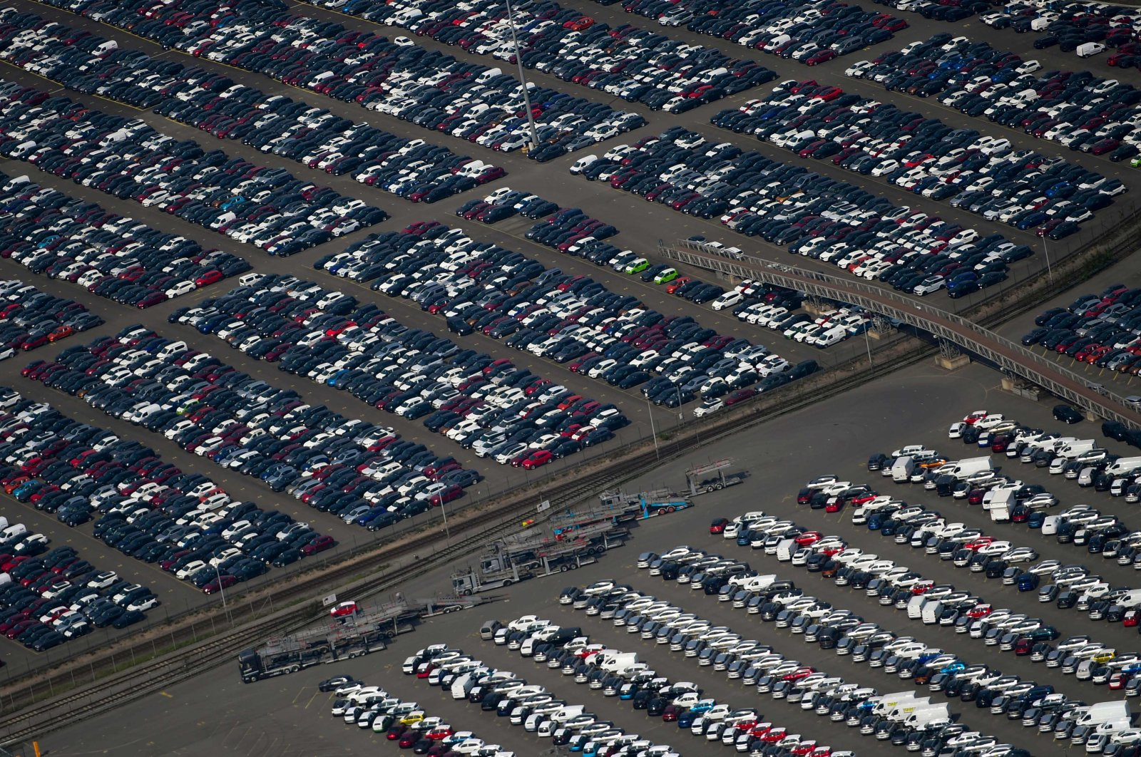 This aerial file photo shows new cars for sale parked at the harbor of Duisburg, western Germany, May 8, 2020. (AFP Photo)