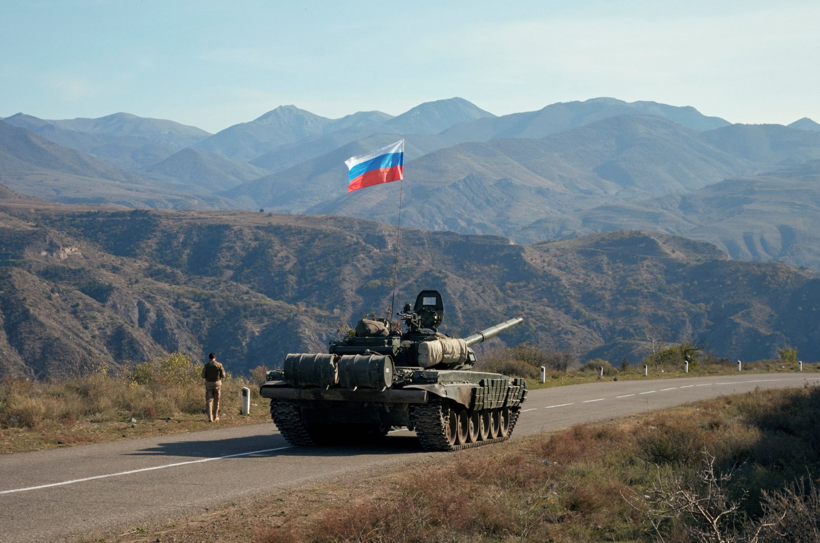 A service member of the Russian peacekeeping troops walks by a tank near the border with Armenia, in the region of Nagorno-Karabakh, Azerbaijan, Nov. 10, 2020. (Reuters Photo)