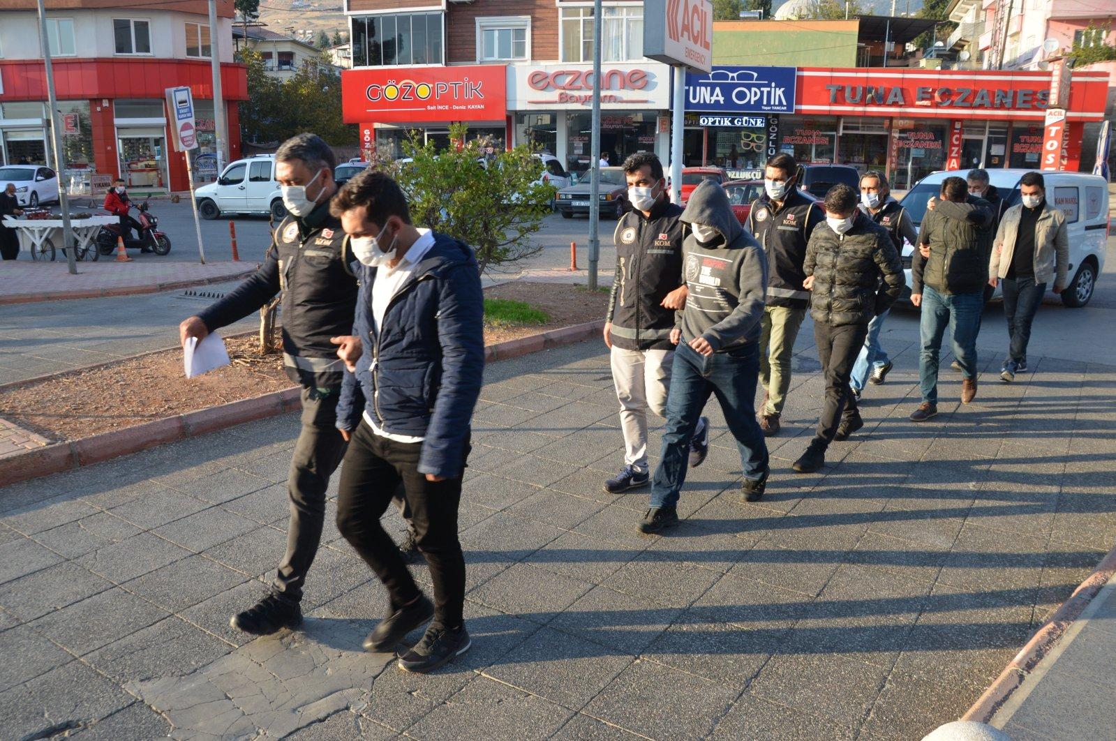 Police officers escort FETÖ suspects in Kahramanmaraş, eastern Turkey, Nov. 18, 2020. (AA Photo)
