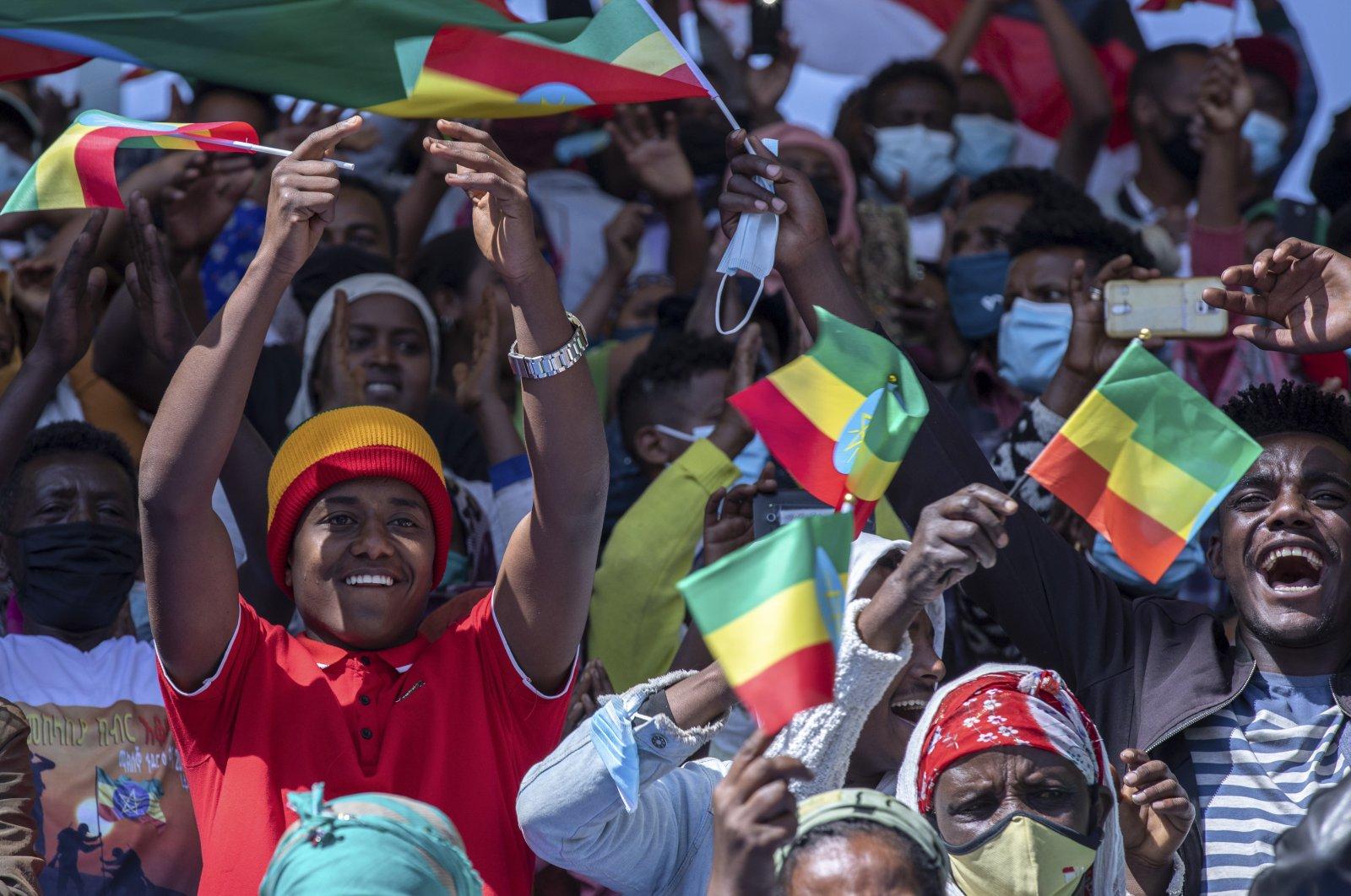 Ethiopians hold national flags at the Abebe Bikila stadium, Addis Ababa, Nov. 17, 2020. (AP Photo)