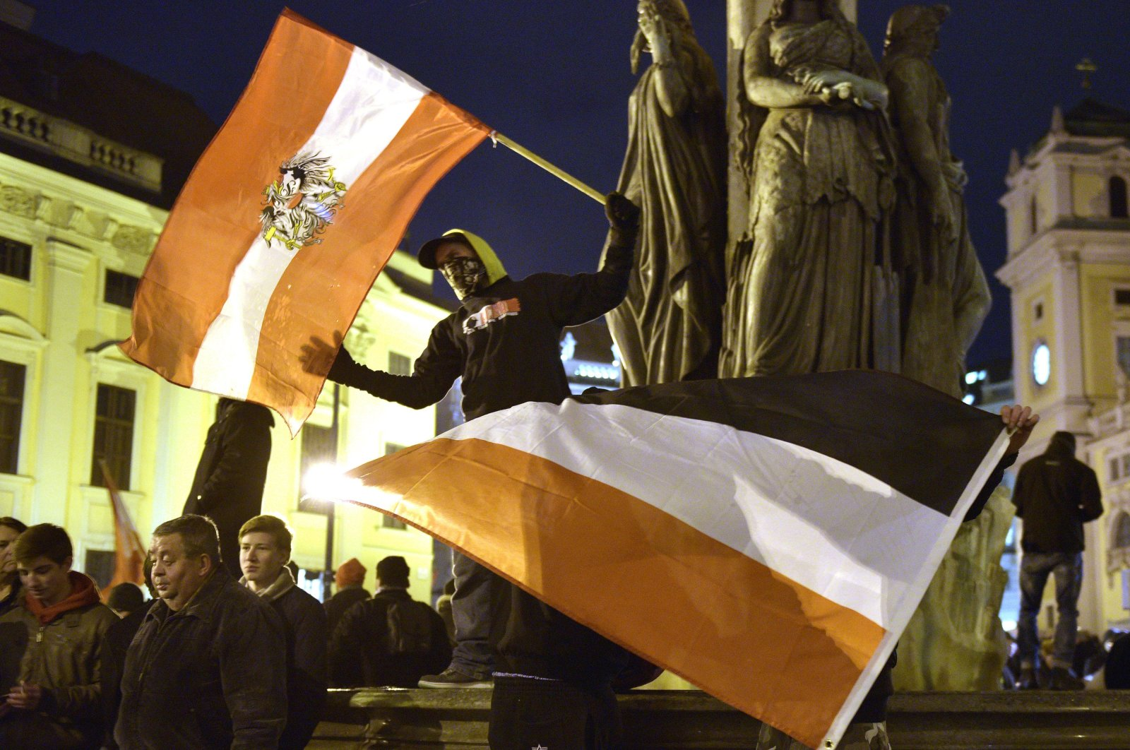 Demonstrators wave flags and show banners during a rally of the group Patriotic Europeans against Muslims, Vienna, Austria, Feb. 2, 2015. (AP Photo)