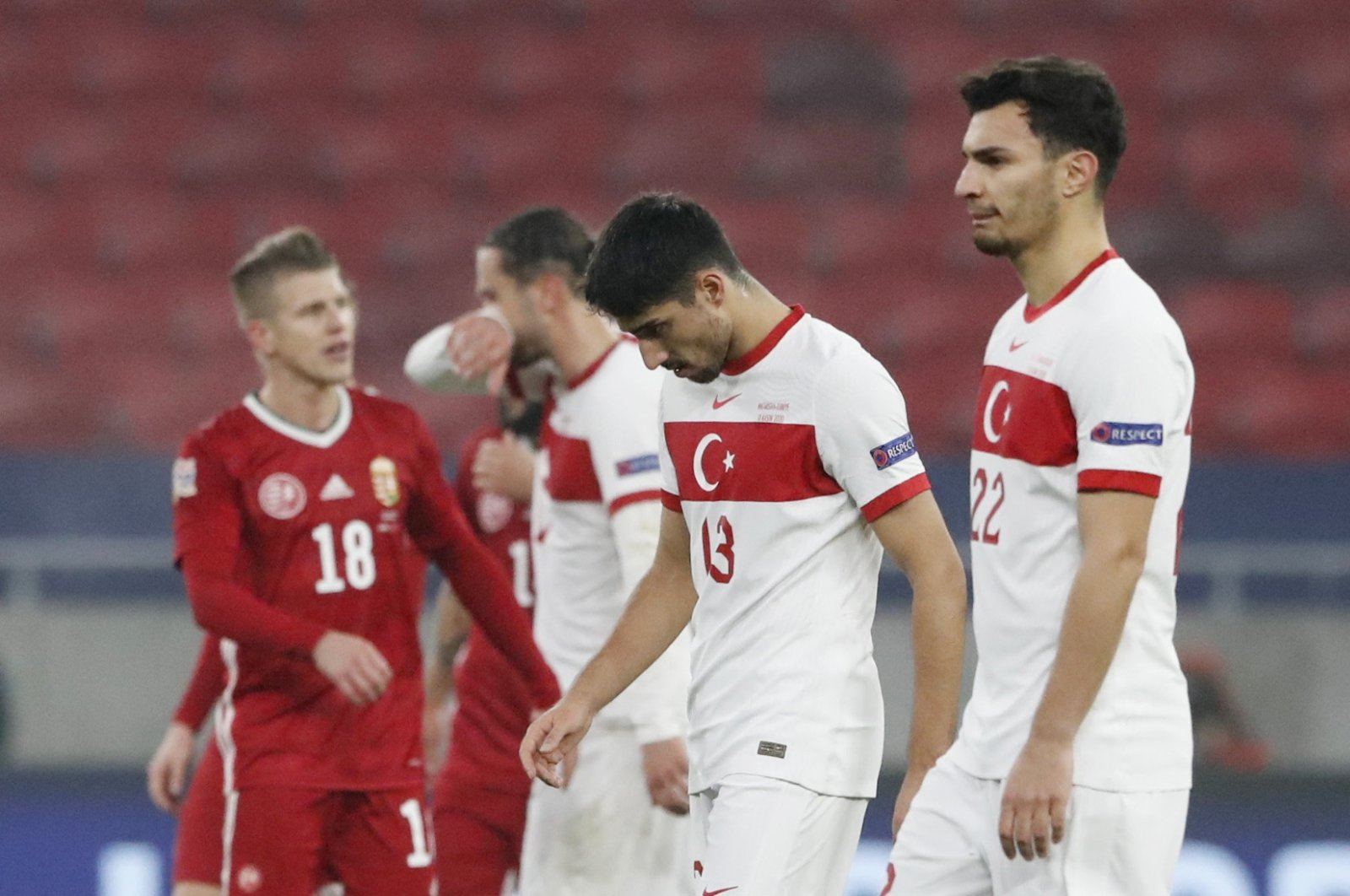 Turkey's Berkay Özcan and Kaan Ayhan look dejected at the end of the match between Hungary and Turkey at Puskas Arena, Budapest, Hungary, Nov. 18, 2020. (Reuters Photo)