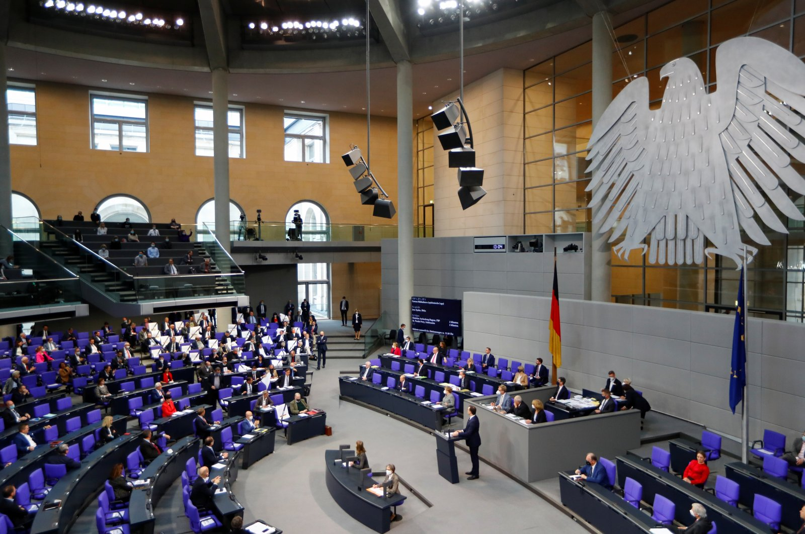 AfD parliament members hold placards as German Health Minister Jens Spahn addresses the parliament during a session of the German lower house of parliament Bundestag, in Berlin, Germany, Nov.18, 2020. (Reuters Photo)
