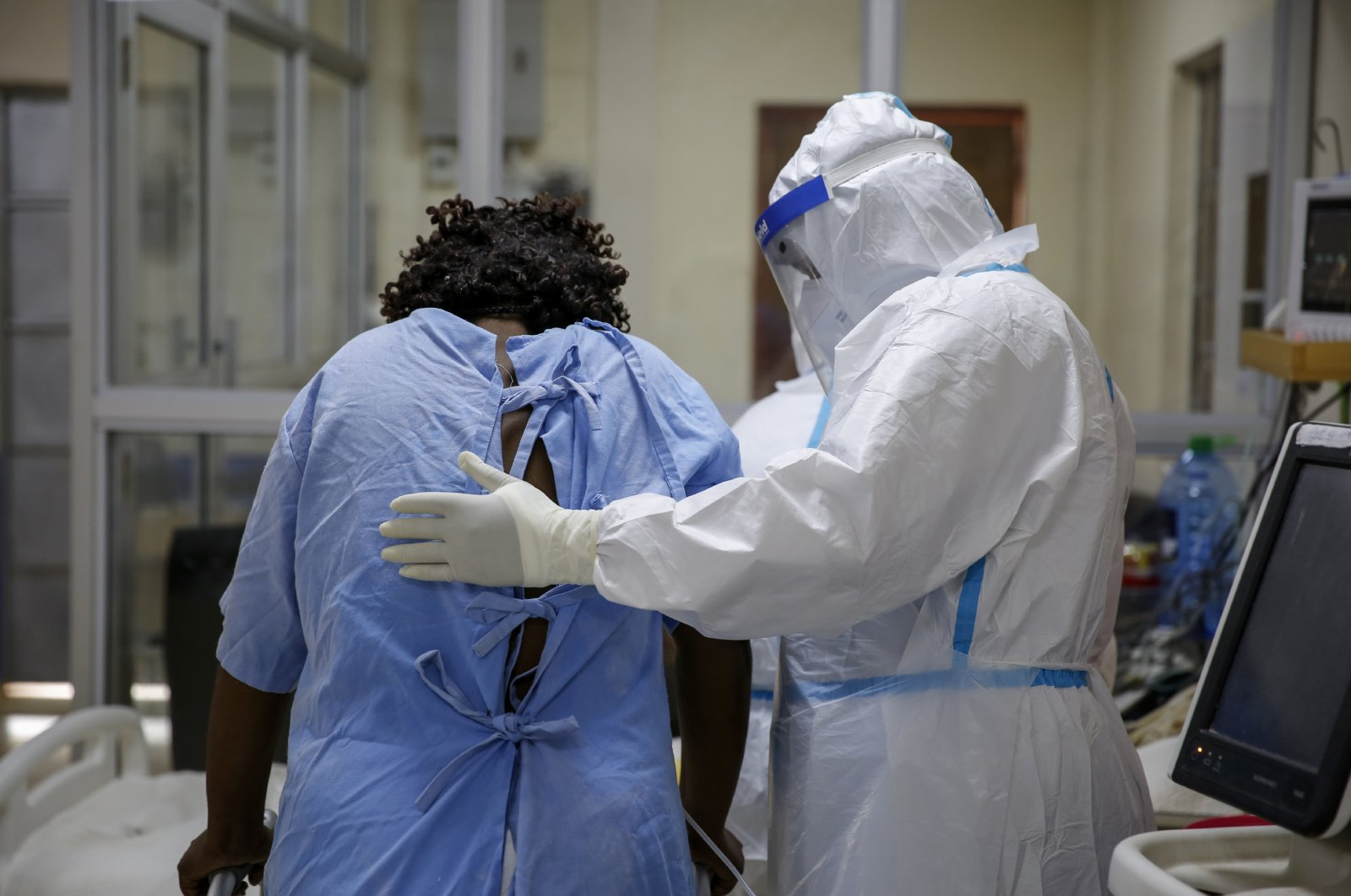 A medical worker attends to a coronavirus patient in the intensive care unit of an isolation and treatment center for those with COVID-19 in Machakos, south of the capital Nairobi, in Kenya, Nov. 3, 2020. (AP Photo)