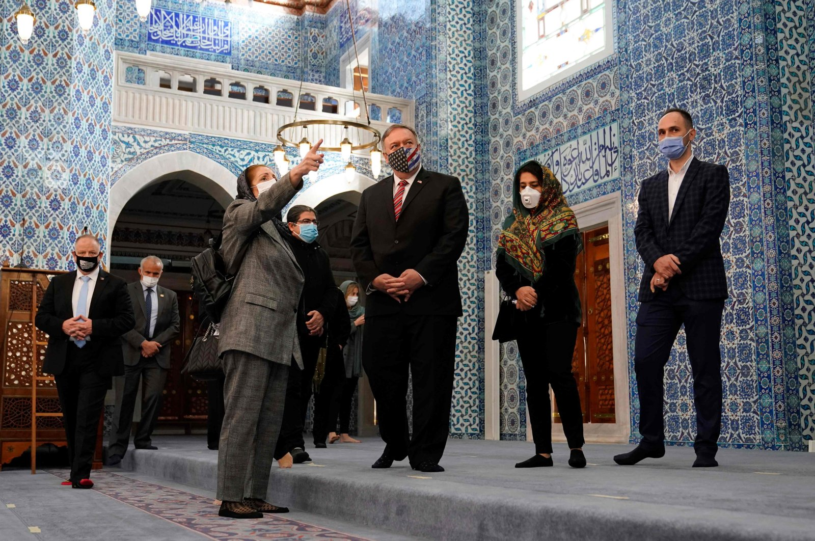 U.S. Secretary of State Mike Pompeo (C) listens to officials as he visits the Rüstem Pasha Mosque, Istanbul, Turkey, Nov. 17, 2020. (AFP Photo)