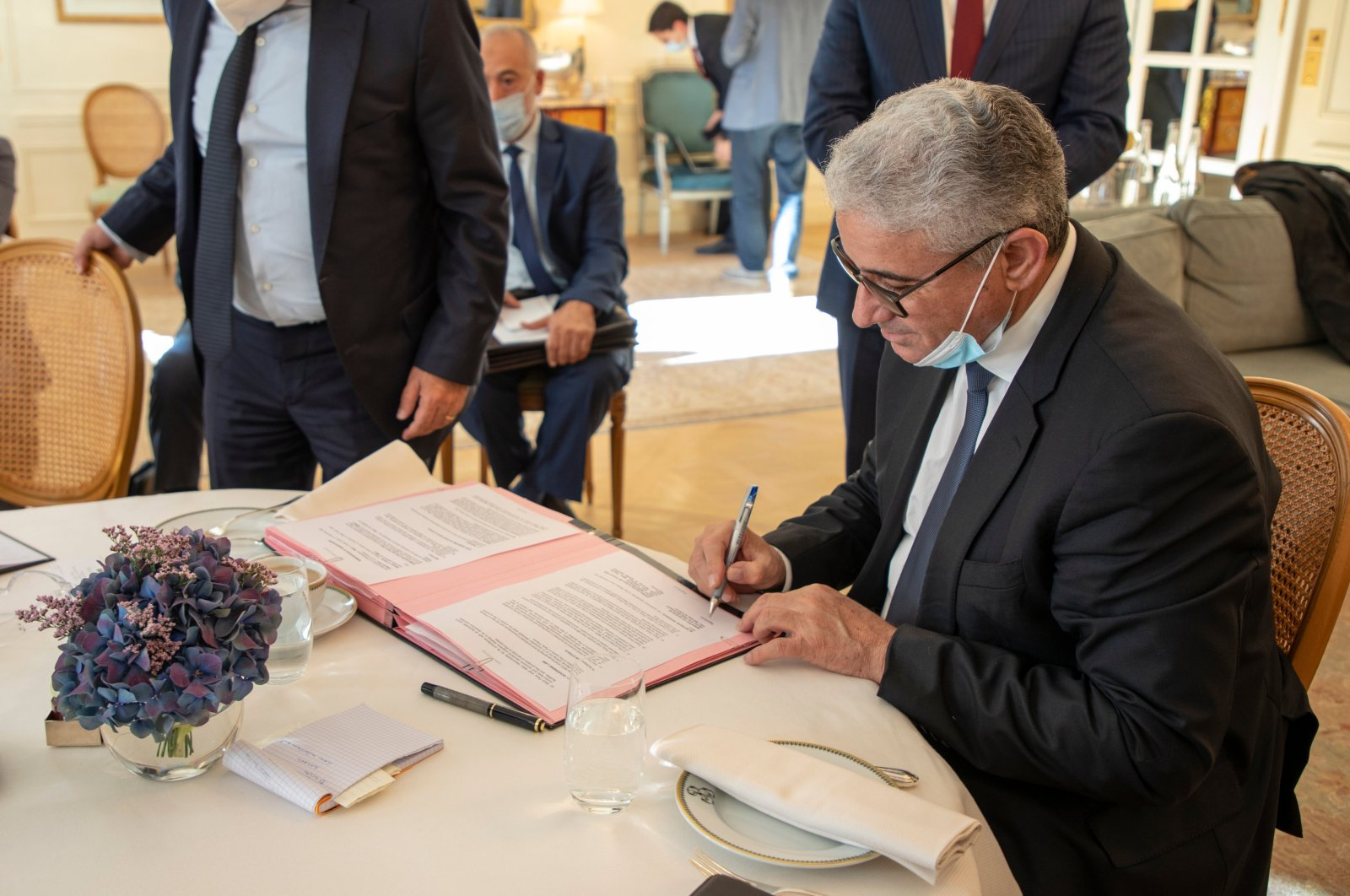 Libya's Interior Minister Fathi Bashagha signs the agreement with Idemia in Paris, France, Nov. 18, 2020. (Photo by Libya's Interior Ministry via AA)