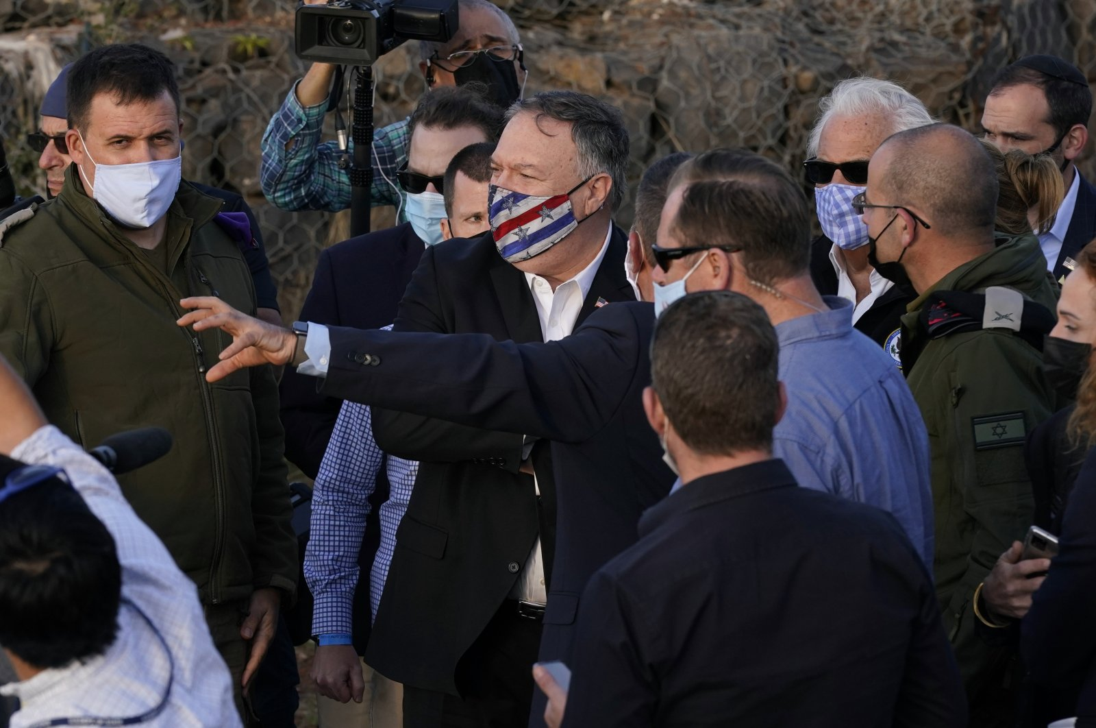 U.S. Secretary of State Mike Pompeo (C) listens during a security briefing on Mount Bental in the Israeli-occupied Golan Heights, overlooking the Israeli-Syrian border, Nov. 19, 2020. (AP Photo)
