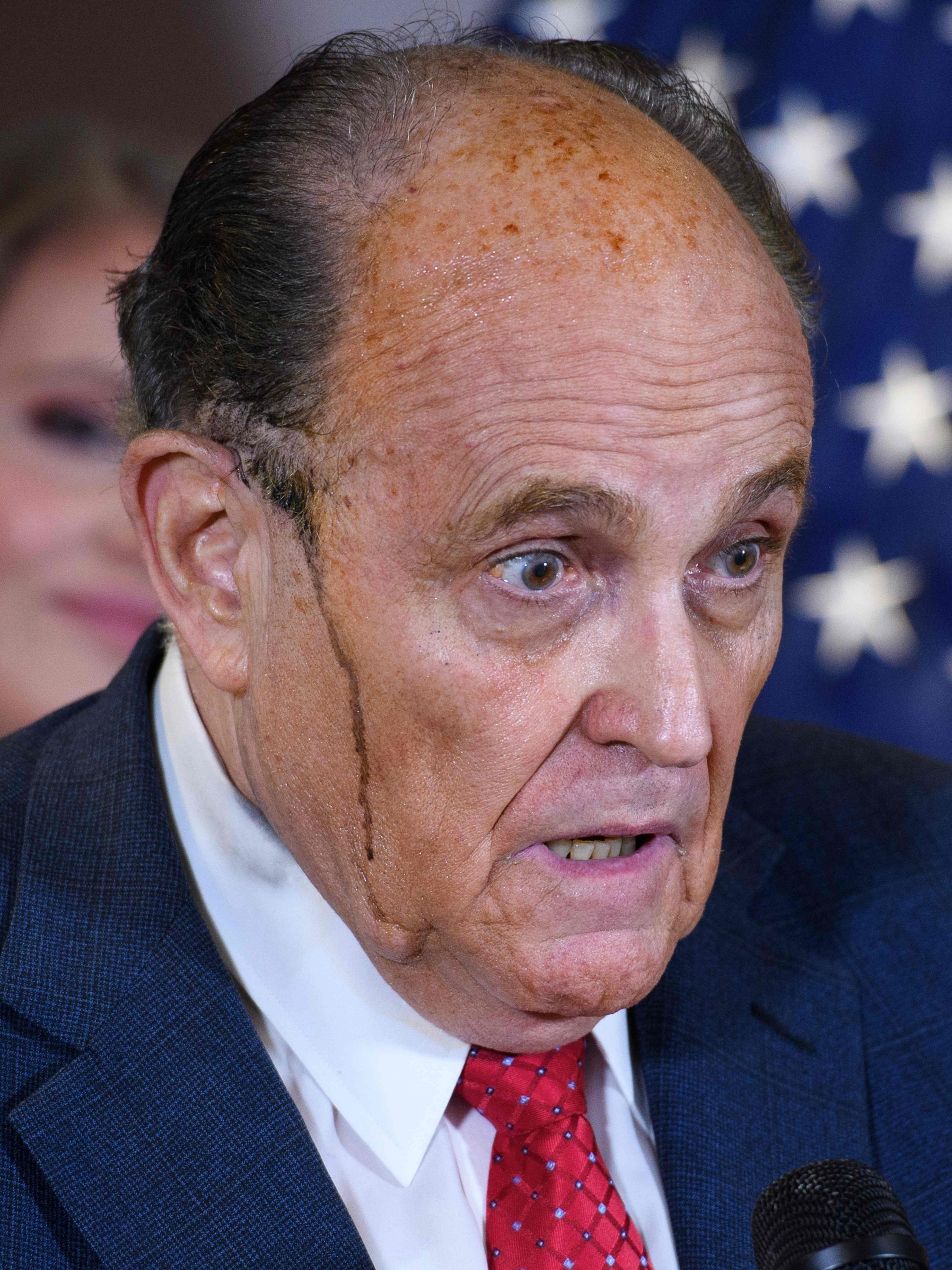 U.S. President Donald Trump's personal lawyer Rudy Giuliani perspires, Washington, D.C., Nov. 19, 2020. (AFP Photo)