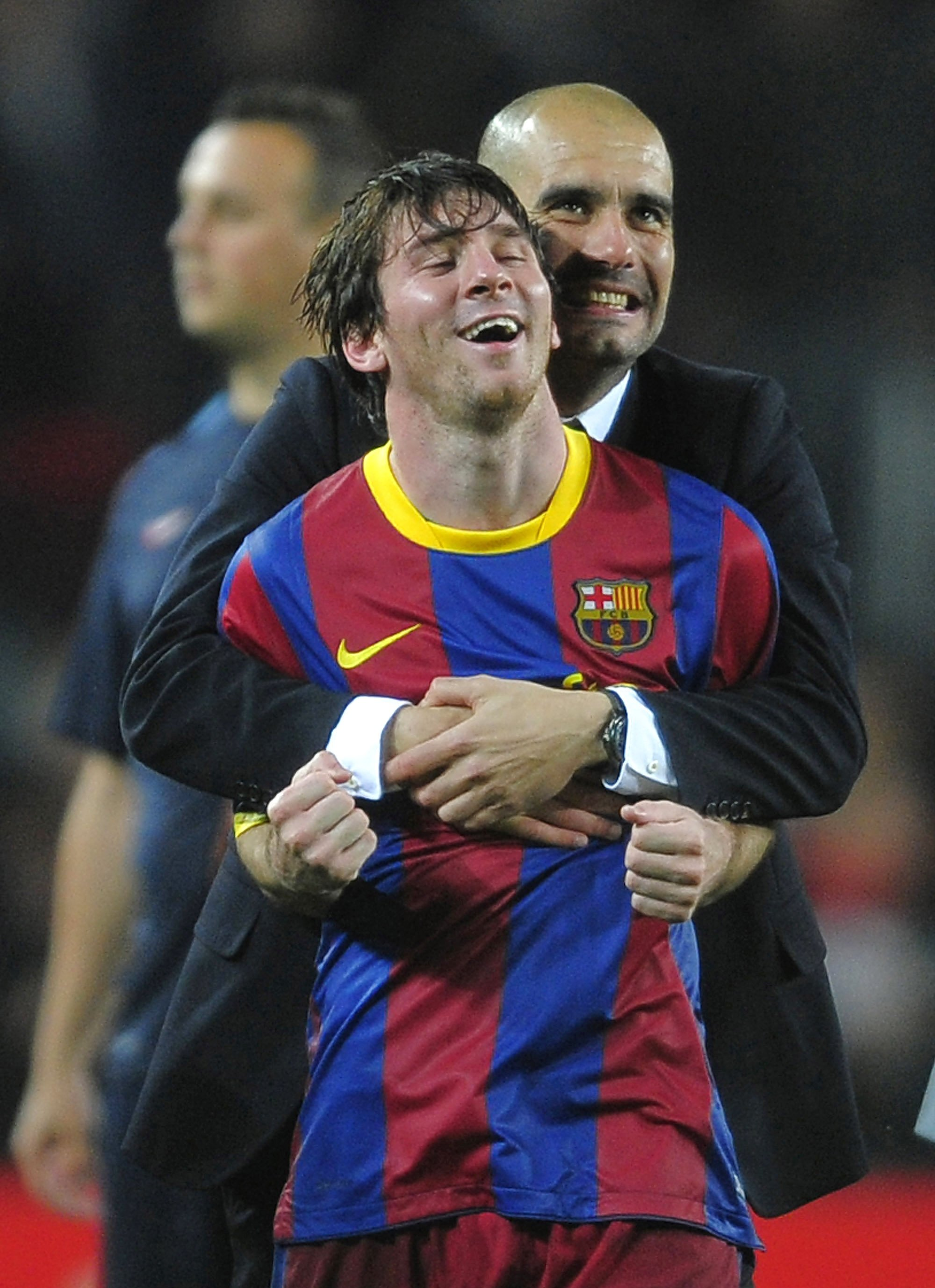 Lionel Messi and Pep Guardiola celebrate a Champions League victory in Barcelona, Spain, May 3, 2011. (AP Photo)