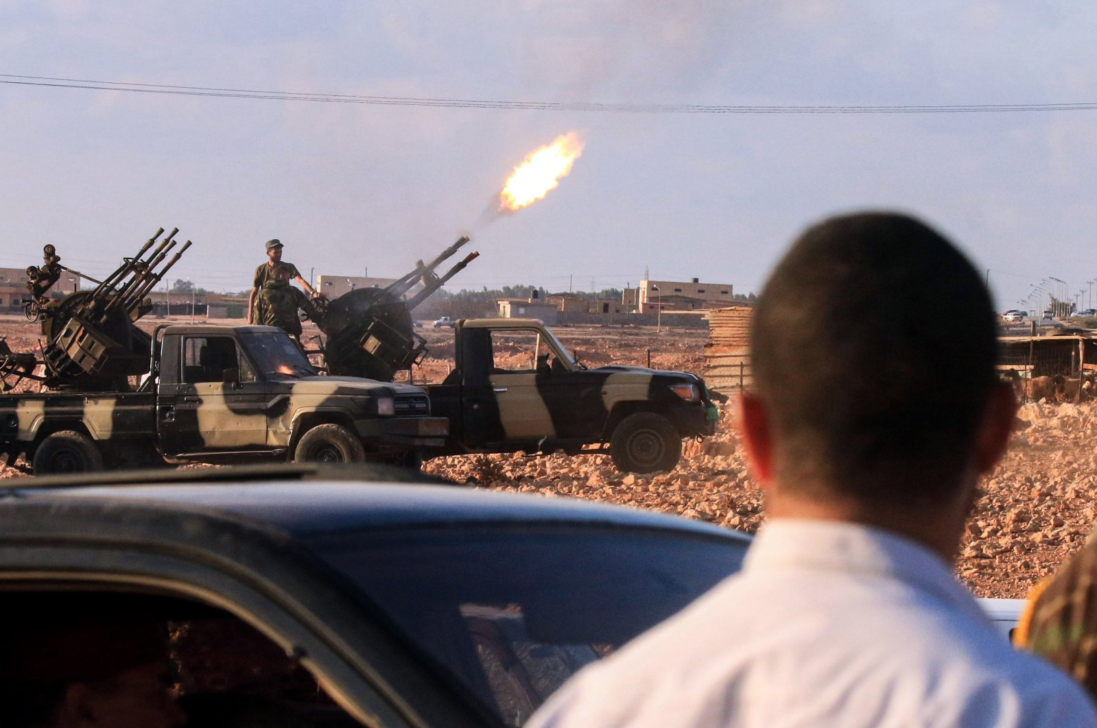 """An anti-aircraft gun fires rounds in tribute during the funeral of a commander of the """"Saiqa"""" (Special Forces) of the self-proclaimed Libyan National Army (LNA) loyal to putschist Gen. Khalifa Haftar, in the eastern city of Benghazi, Libya, Nov. 1, 2020. (AFP Photo)"""