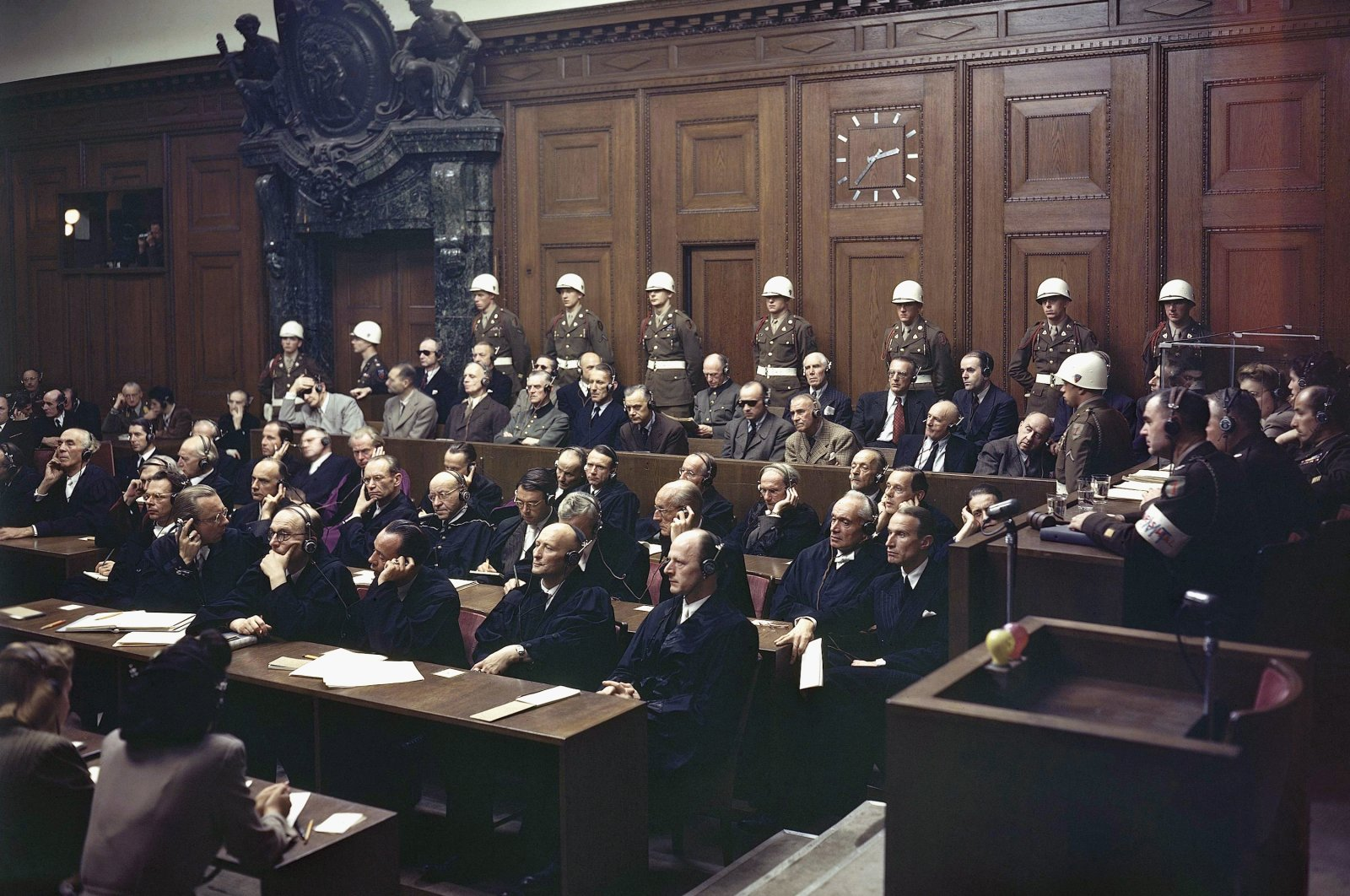 In this file photo, defendants listen to part of the verdict in the Palace of Justice during the Nuremberg War Crimes Trial in Nuremberg, Germany on Sept. 30, 1946. (AP Photo)