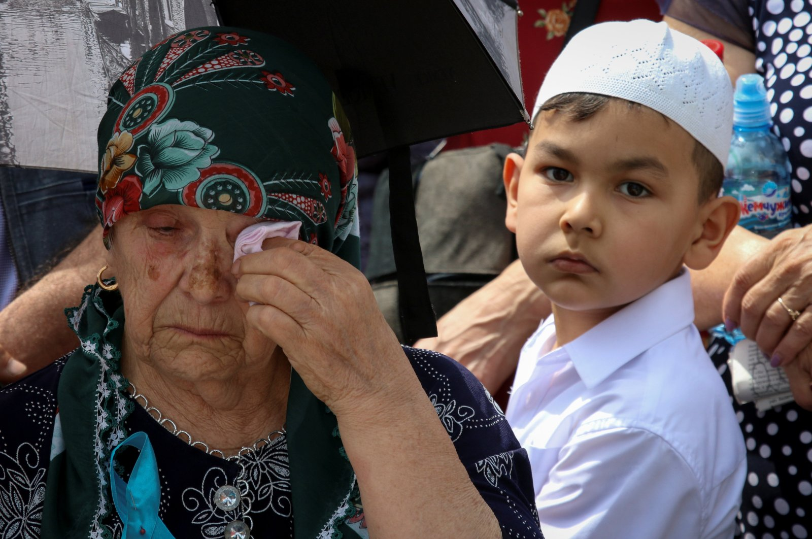 A woman reacts at a rally commemorating Crimean Tatars' mass deportations from the region in 1944, in the village of Siren in Bakhchisaray, Crimea, Ukraine, May 18, 2019. (Reuters Photo)