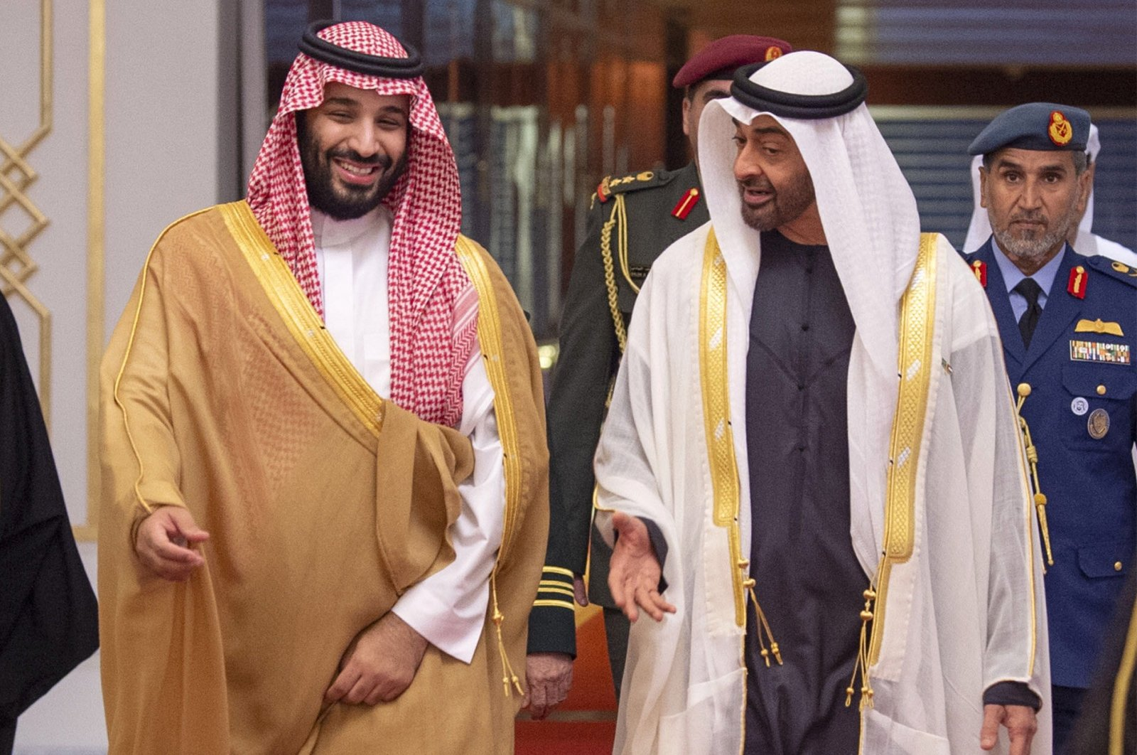 A handout picture provided by the Saudi Royal Palace shows Saudi Crown Prince Mohammed bin Salman (L) being received by Abu Dhabi's crown prince and deputy supreme commander of the UAE armed forces, Sheikh Mohamed bin Zayed Al Nahyan, upon the former's arrival in Abu Dhabi, Nov. 22, 2018. (AFP Photo)