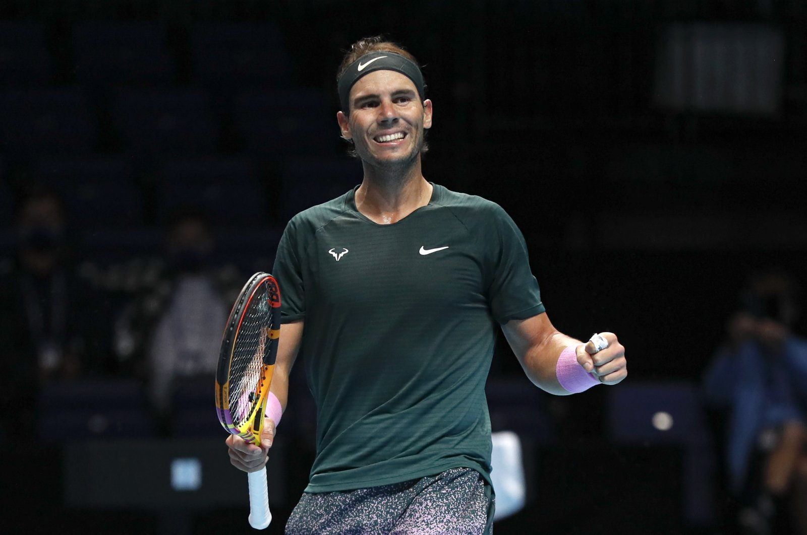 Rafael Nadal of Spain celebrates defeating Stefanos Tsitsipas of Greece at the ATP World Finals tennis tournament at the O2 arena in London, Thursday, Nov. 19, 2020. (AP Photo)