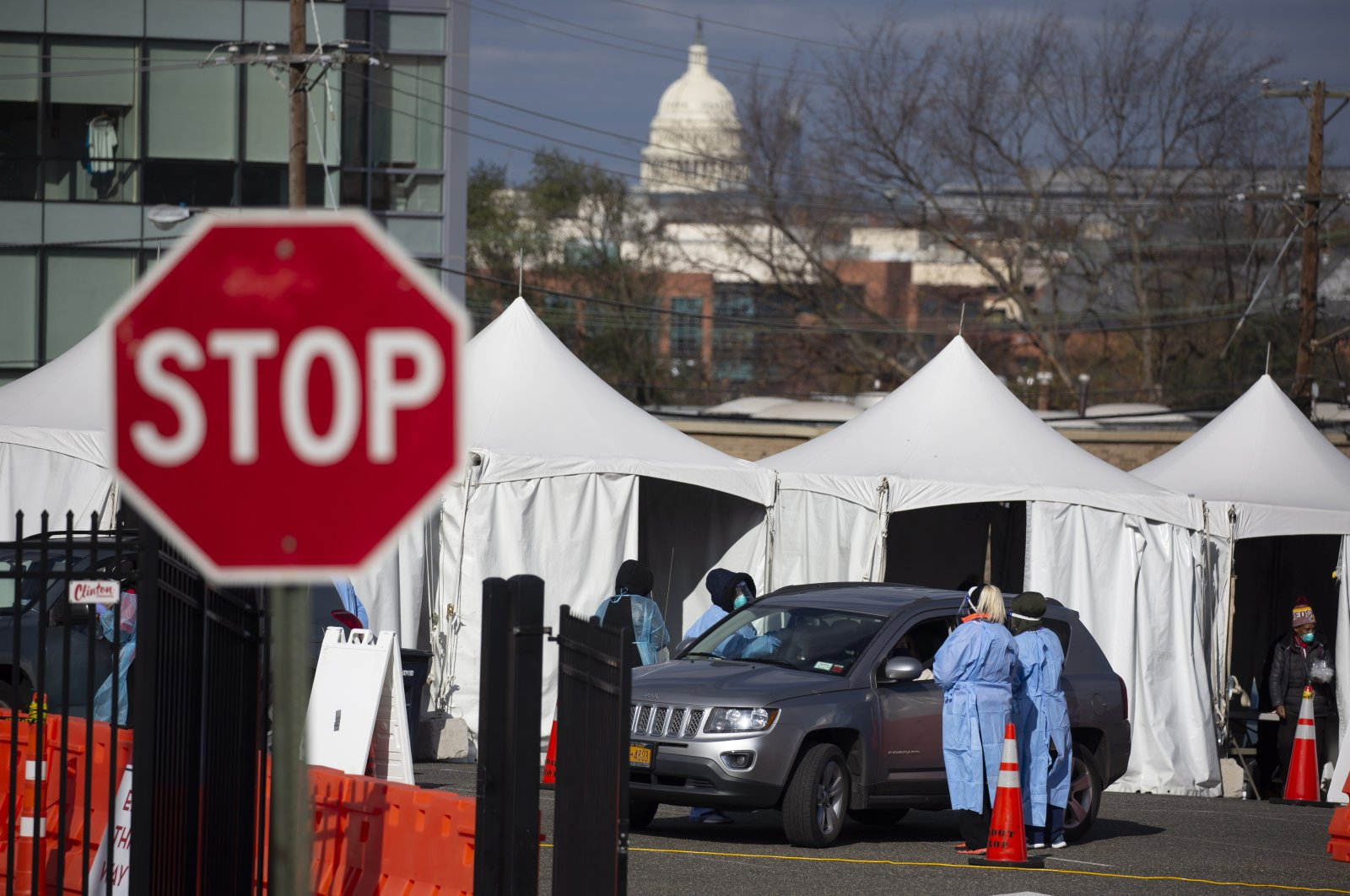 People in vehicles are tested with a swab at a drive-thru COVID-19 testing site operated by the District of Columbia, with the U.S. Capitol seen in the background, in Washington, the U.S., Nov. 18, 2020. (EPA Photo)