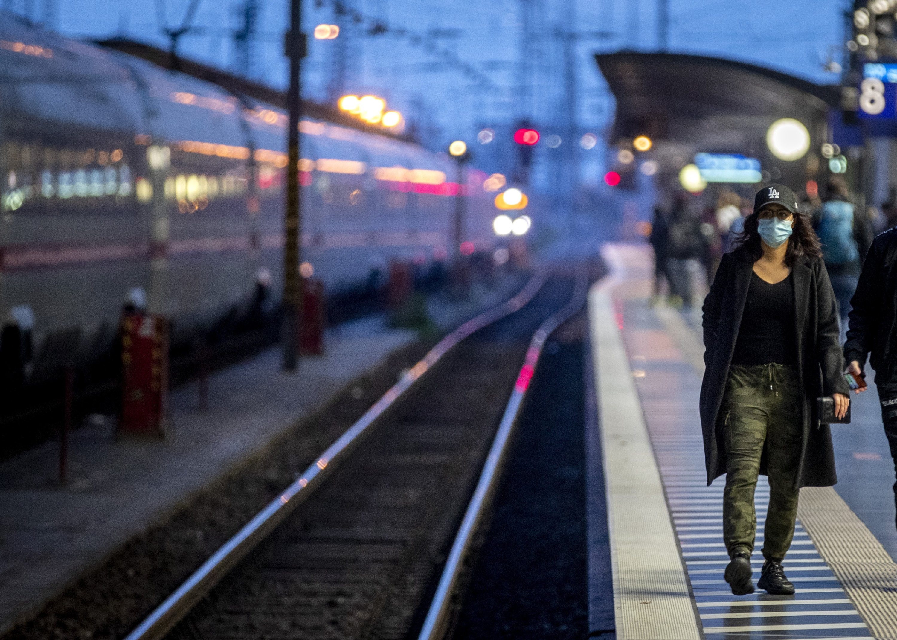 A traveller wearing a face mask arrives at the main train station in Frankfurt, Germany, Sunday, Nov. 8, 2020. (AP Photo)