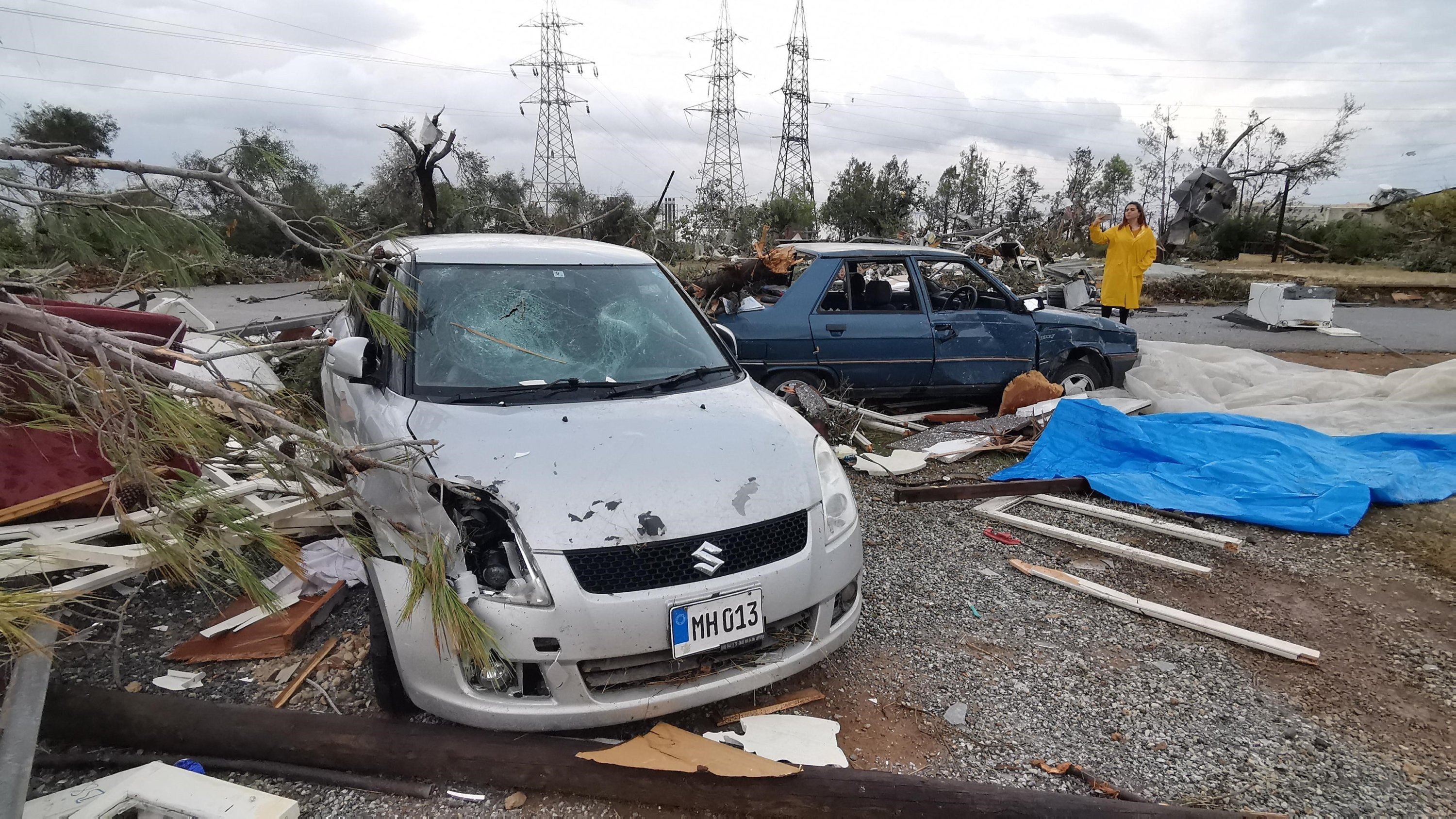 Damaged buildings and vehicles are seen in the aftermath of a tornado, in the Girne district, the Turkish Republic of Northern Cyprus (TRNC), Nov. 21, 2020. (IHA Photo)