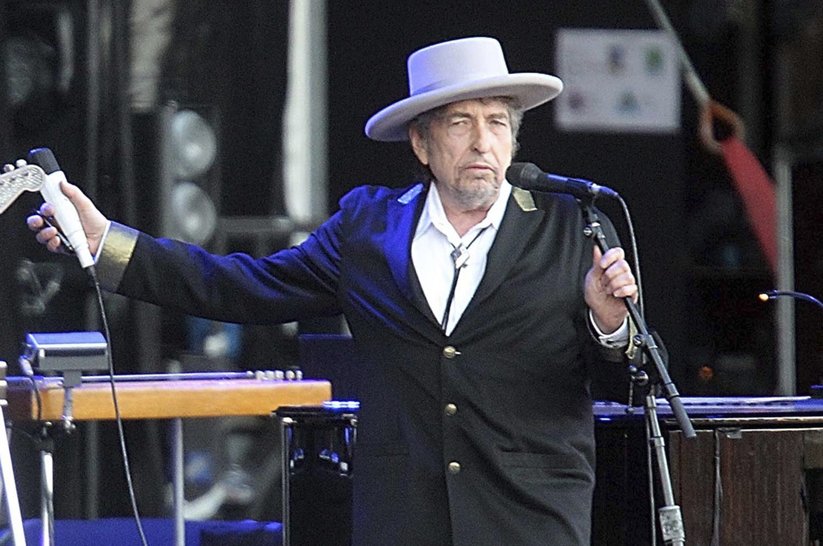 """U.S. singer-songwriter Bob Dylan performing onstage at """"Les Vieilles Charrues"""" Festival in Carhaix, western France on July 22, 2012. (AP Photo)"""