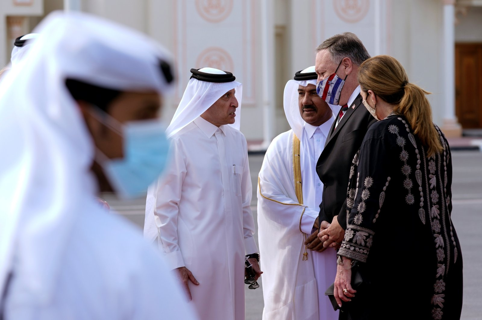 Qatar Airways CEO Akbar Al Baker and Qatari Ministry of Foreign Affairs secretary general Ahmed bin Hassan Al Hammadi greet U.S. Secretary of State Mike Pompeo, and his wife Susan as they arrive at Old Doha International Airport, Qatar, Nov. 21, 2020. (Reuters Photo)