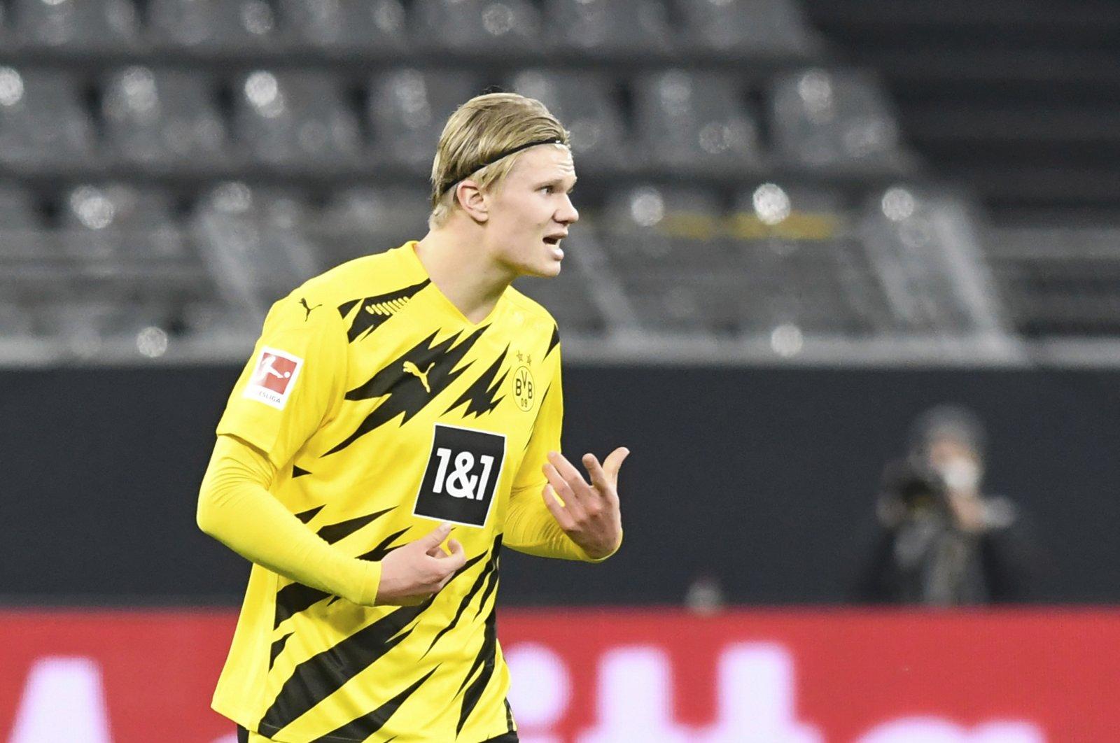 Dortmund's Erling Haaland celebrates scoring a goal during the German Bundesliga soccer match between Borussia Dortmund and Bayern Munich at Signal Iduna Park, in Dortmund, Germany, Nov. 7, 2020. (Pool via AP)