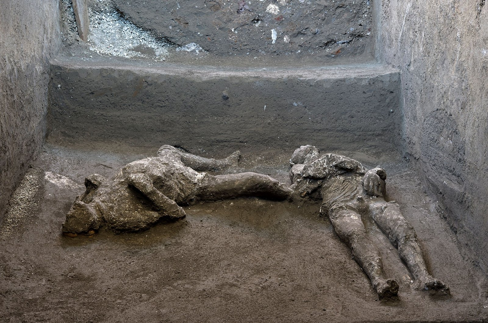 Remains of two men who died in the volcanic eruption that destroyed the ancient Roman city of Pompeii in 79 A.D. are discovered in a dig carried out during the coronavirus pandemic in Pompeii, Italy on Nov. 18, 2020. (Reuters Photo)
