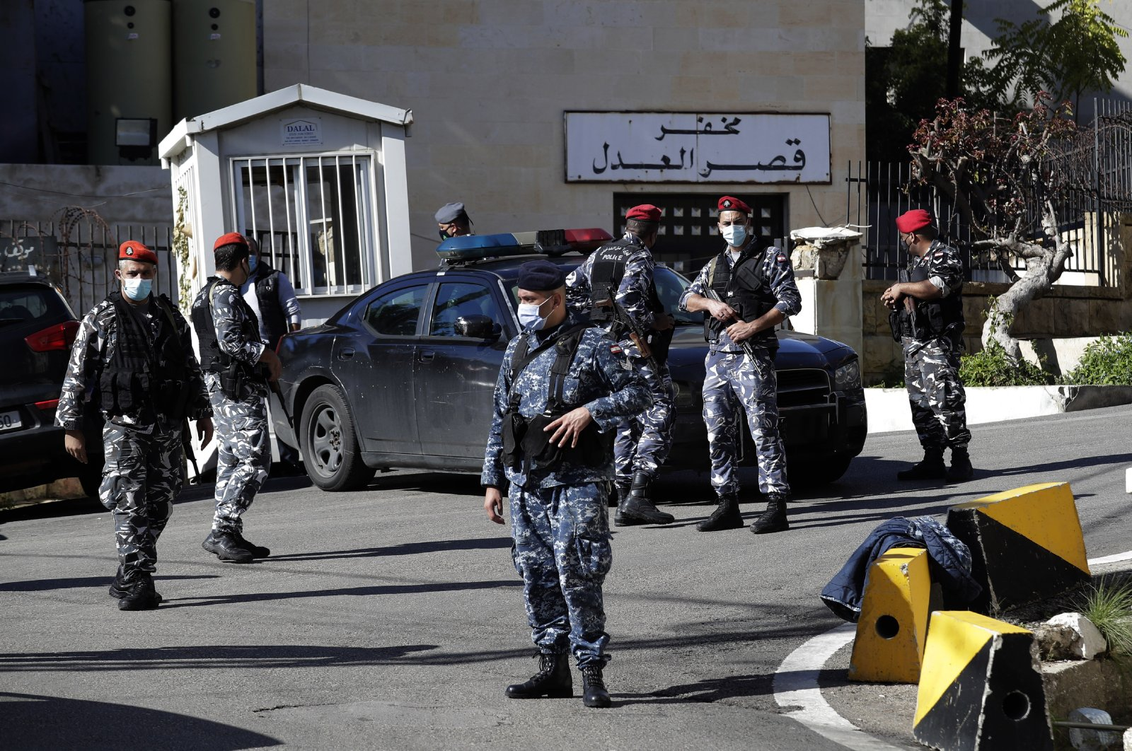 Lebanese policemen stand guard a detention center of Baabda courthouse compound were nearly 70 inmates broke out of a prison early Saturday after smashing their cell doors and attacking prison guards, in the Beirut southeastern suburb of Baabda, Lebanon, Saturday, Nov. 21, 2020. (AP Photo)