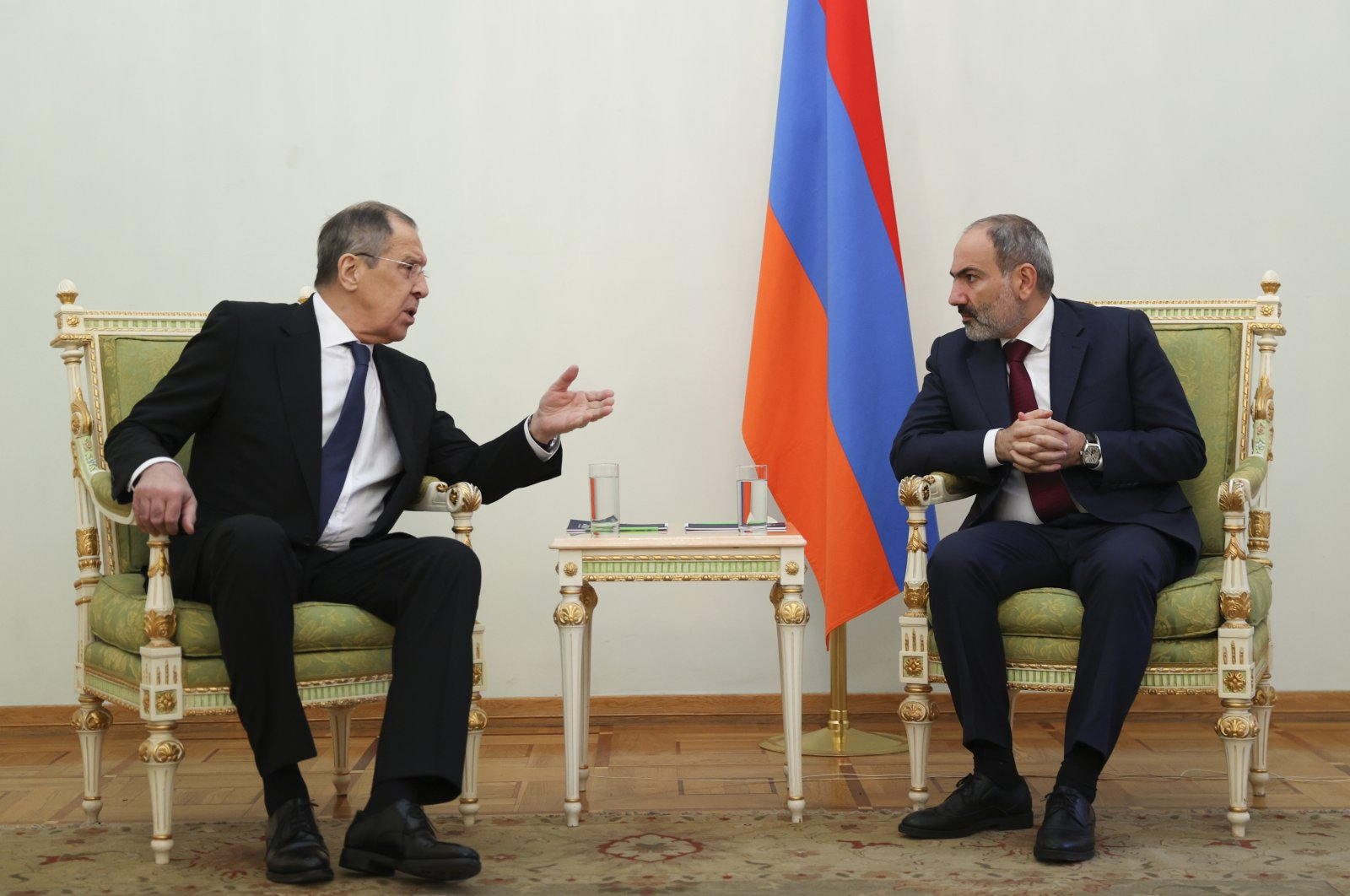 In this photo released by the Russian Foreign Ministry Press Service, Russian Foreign Minister Sergey Lavrov, left, gestures while speaking to Armenia's Prime Minister Nikol Pashinian during their meeting in Yerevan, Armenia, Saturday, Nov. 21, 2020. (AP Photo)