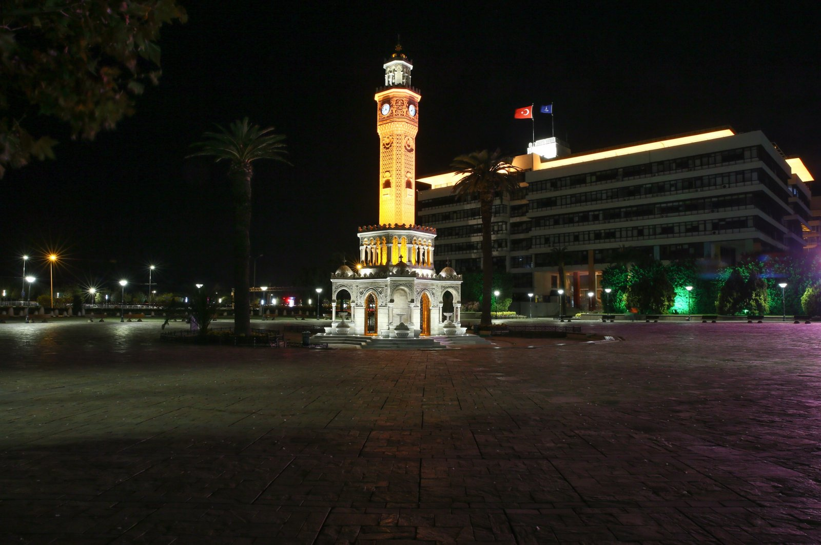 The historic clock tower at the Konak Square in the western city of Izmir is seen deserted during a nighttime curfew, on Nov. 21, 2020. (AA Photo)