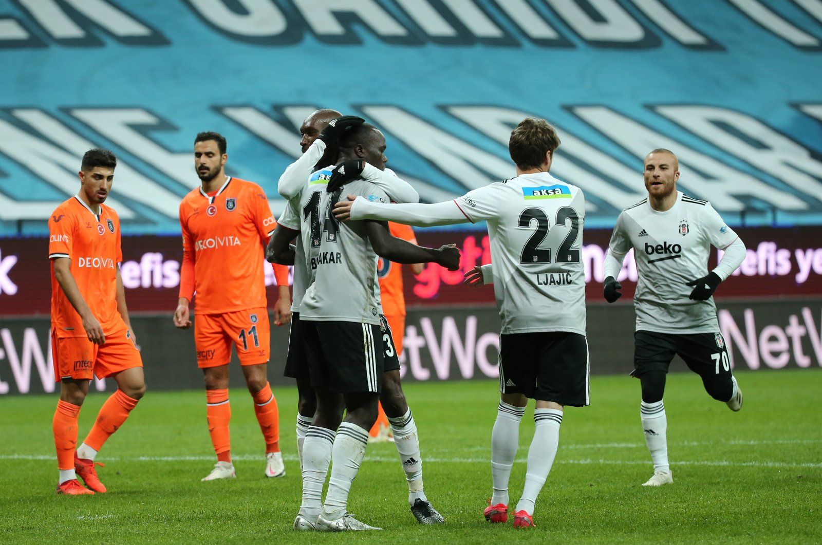 Beşiktaş players celebrate after Vincent Aboubakar scores his team's third goal in the 72nd minute during a Turkish Süper Lig match against başakşehir, at the Vodafone Park, in Istanbul, Nov. 21, 2020. (AA Photo)