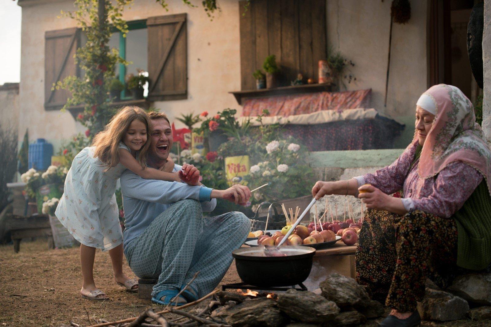 "A still shot showing Ova (L), Memo (C) and grandmother Fatma in a scene from ""7. Koğuştaki Mucize."""