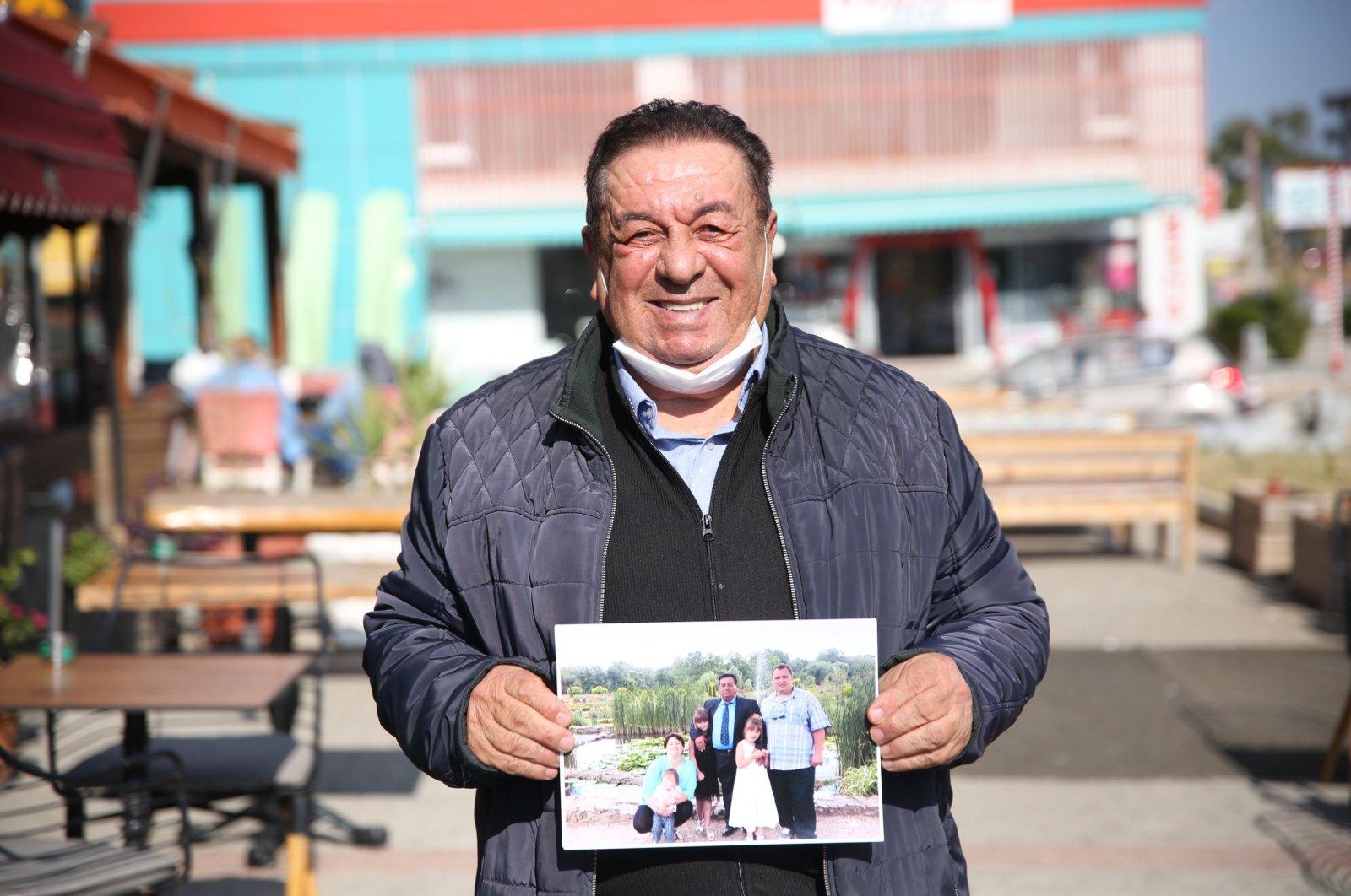 Ahmet Büyüközdemir tells the story of opening his home and heart 28 years ago to a homeless Russian boy named Vladislav Nelbuyin, Antalya, Turkey, Nov. 18, 2020. (AA Photo)