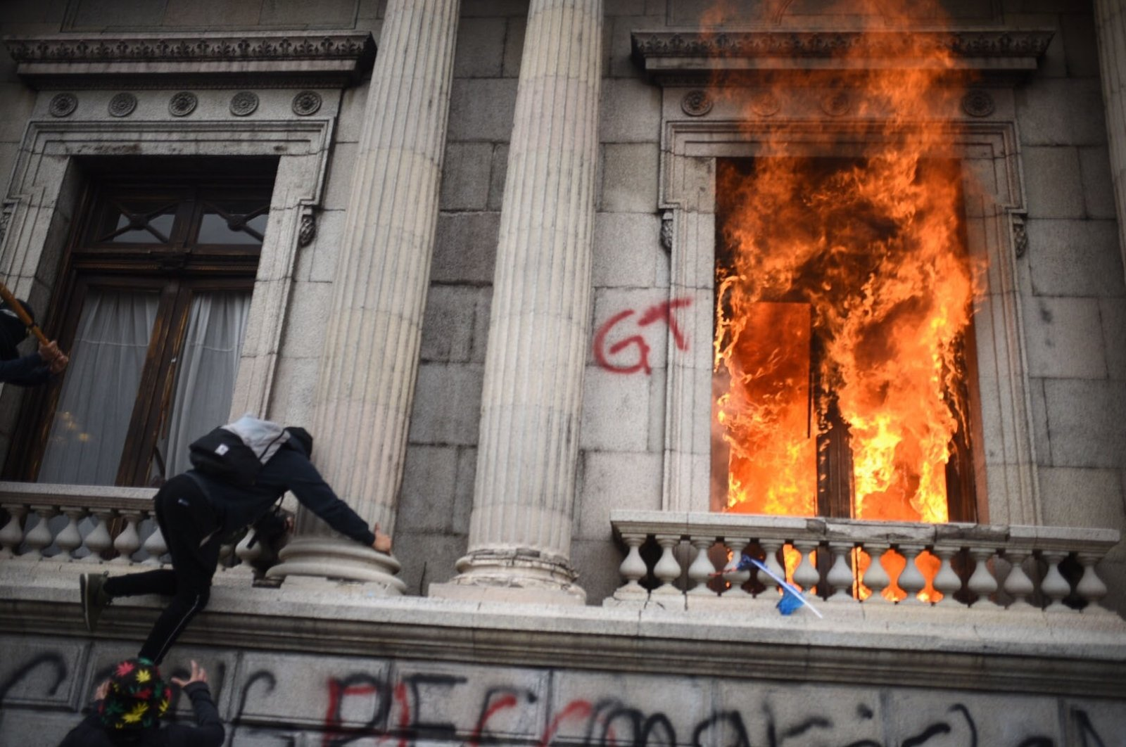 The Guatemalan congress building is set on fire during an anti-government protest, Guatemala City, Nov. 21, 2020. (EPA Photo)