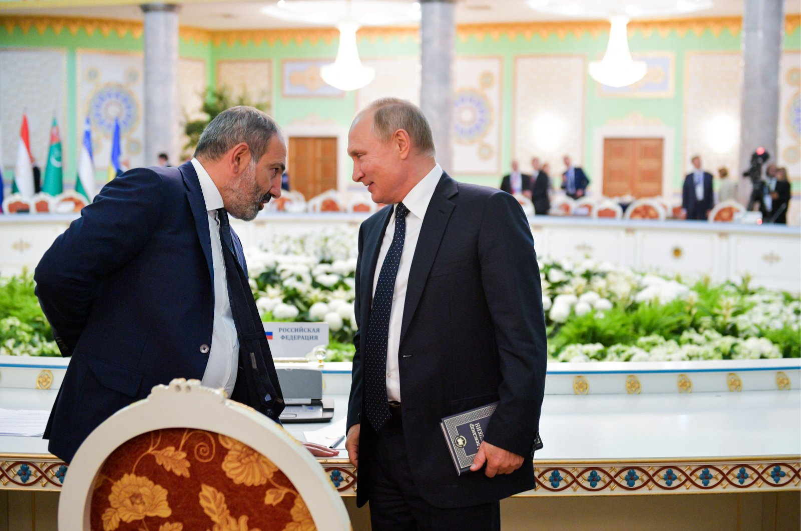 Russia's President Vladimir Putin and Armenia's Prime Minister Nikol Pashinian at a Commonwealth of Independent States (CIS) meeting at the Somon Palace, Dushanbe, Tajikistan, Sept. 28, 2018. (Photo by Getty Images)